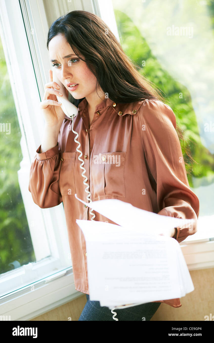 Woman complaining on the phone - Stock Image