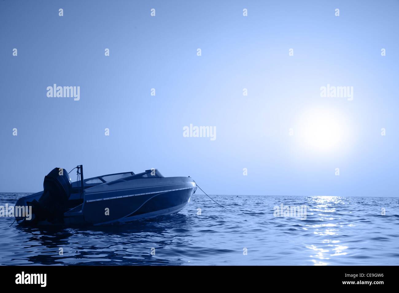 Motorized boat and sea at sunrise - Stock Image