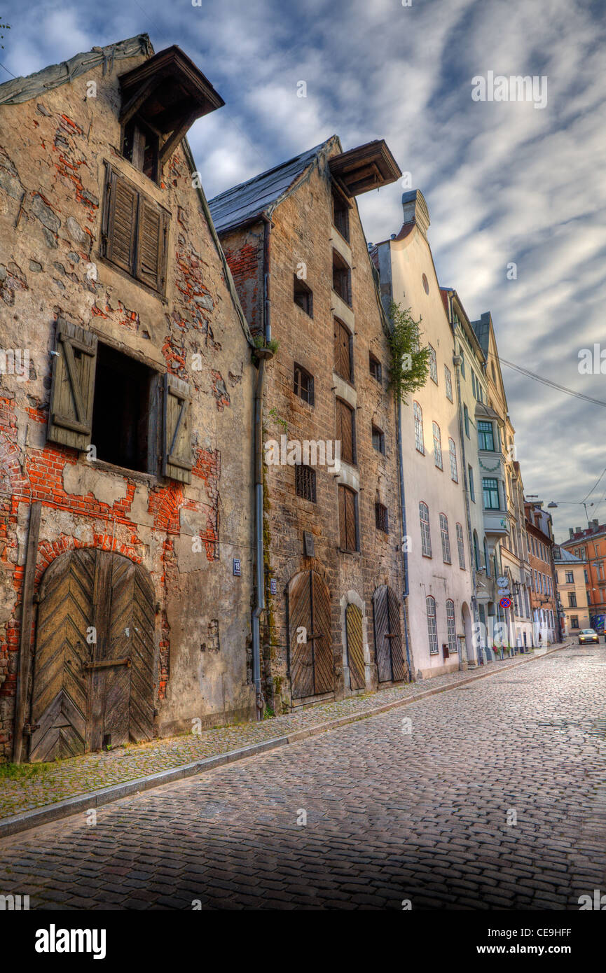 Vertical oriented image of old historic houses on the street of Riga, Latvia. - Stock Image