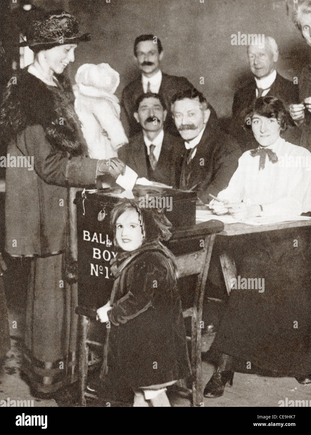 A British woman voting for the first time in the General Election of 1918. - Stock Image