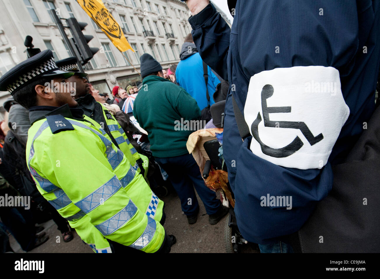 UK Uncut joins forces with a group of disabled, sick and elderly people to engage in an act of civil disobedience. - Stock Image