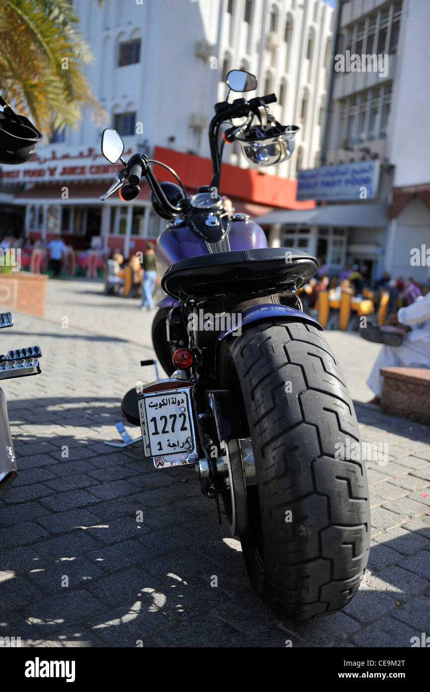 A kuwaiti biker has parked his chopper in front of the Muttrah' souk; Muscat, Oman. - Stock Image