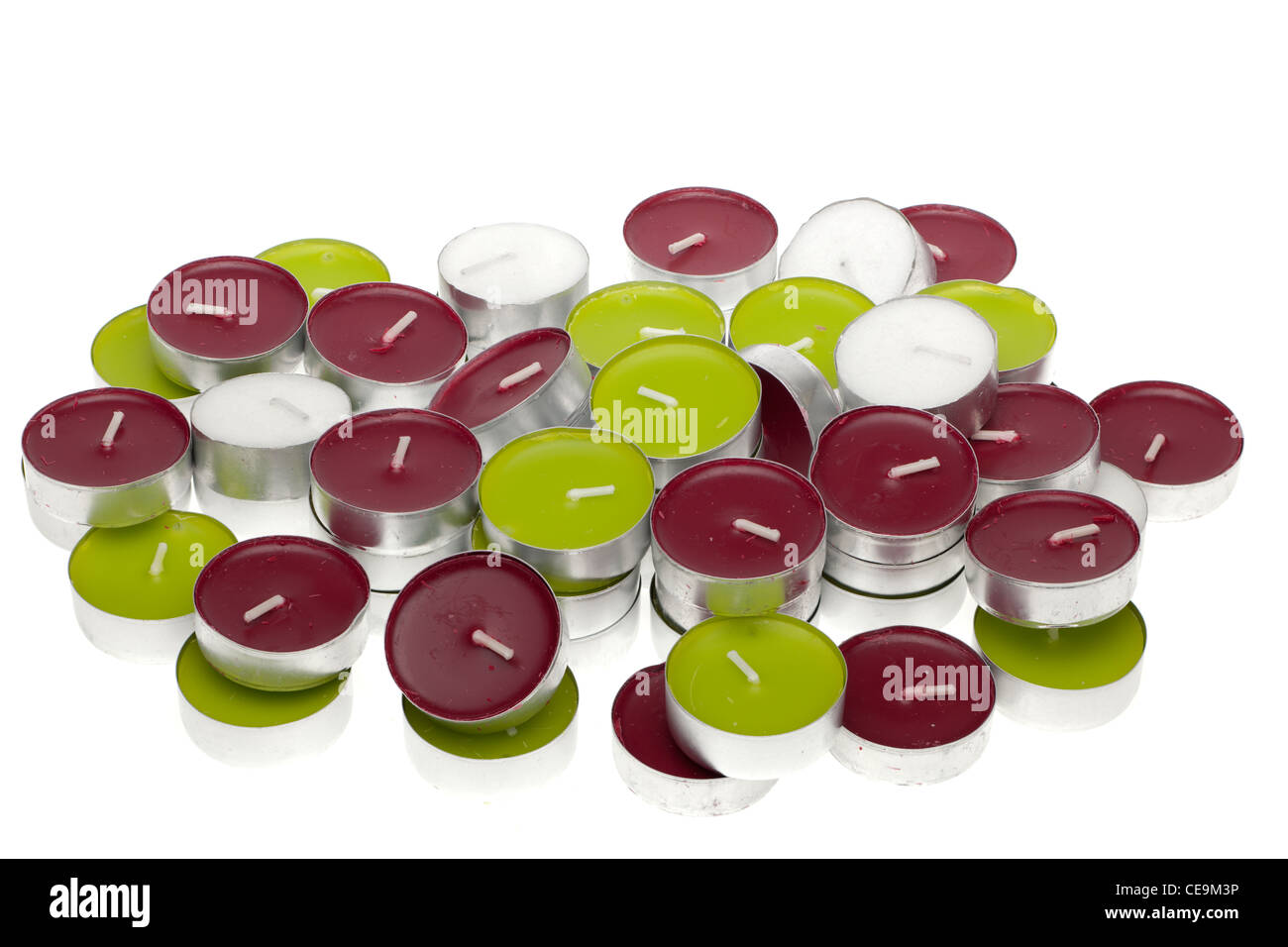 Pile of assorted tea lights candles - Stock Image