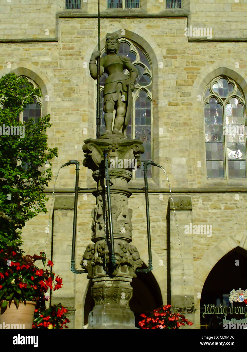 A figure of the Roland fountain on the central market place of Hildesheim in Germany - Stock Image