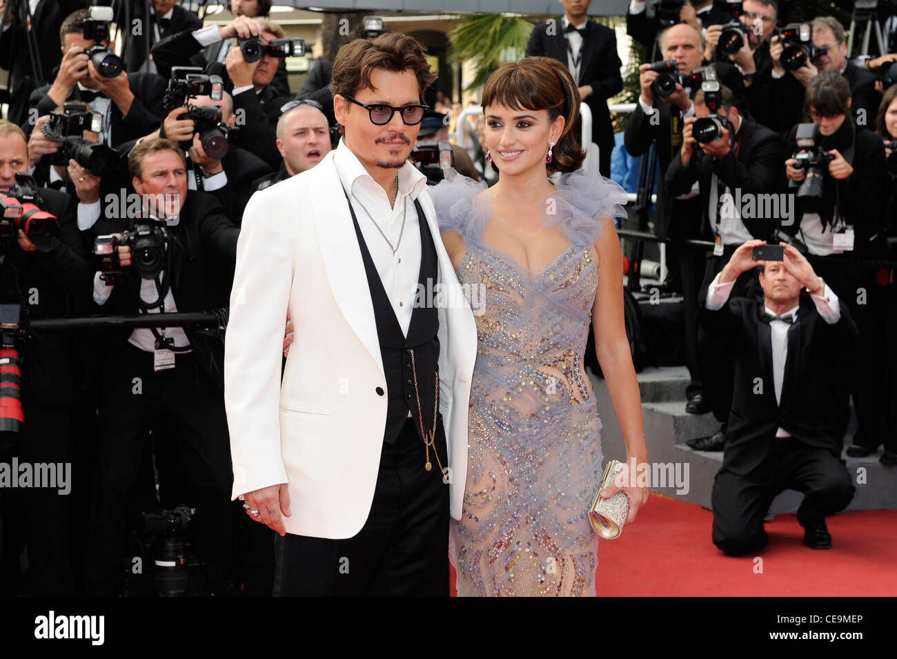 Johnny Depp and Penélope Cruz arrive for the screening of Pirates of the Caribbean: On Stranger Tides. - Stock Image