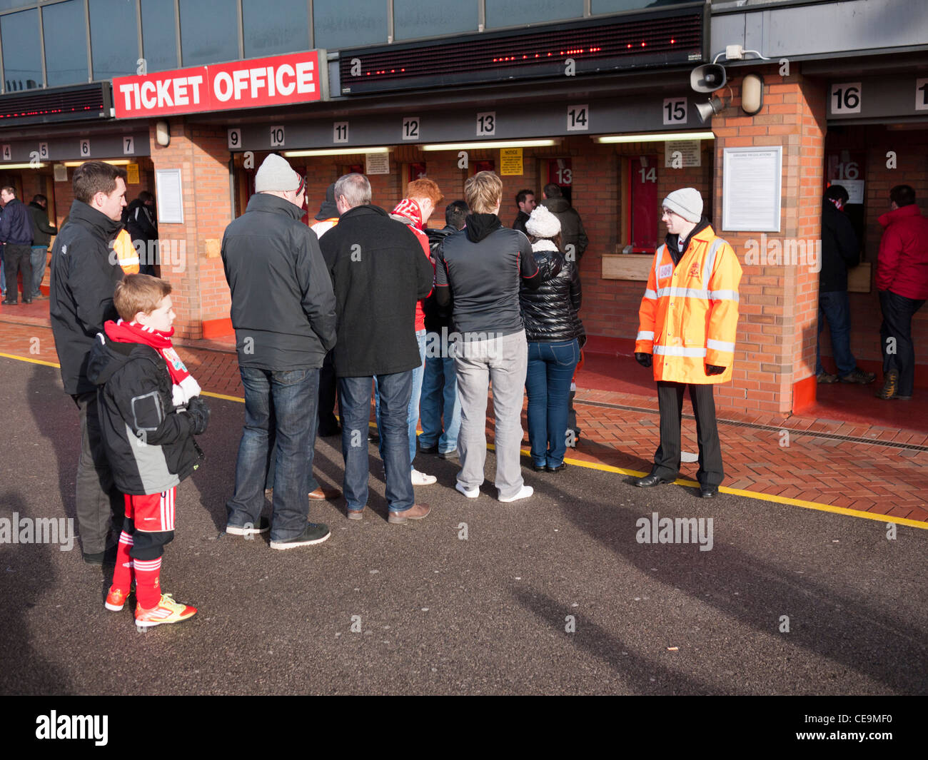 Football supporters queuing at ticket kiosk at Anfield football ground Liverpool England - Stock Image