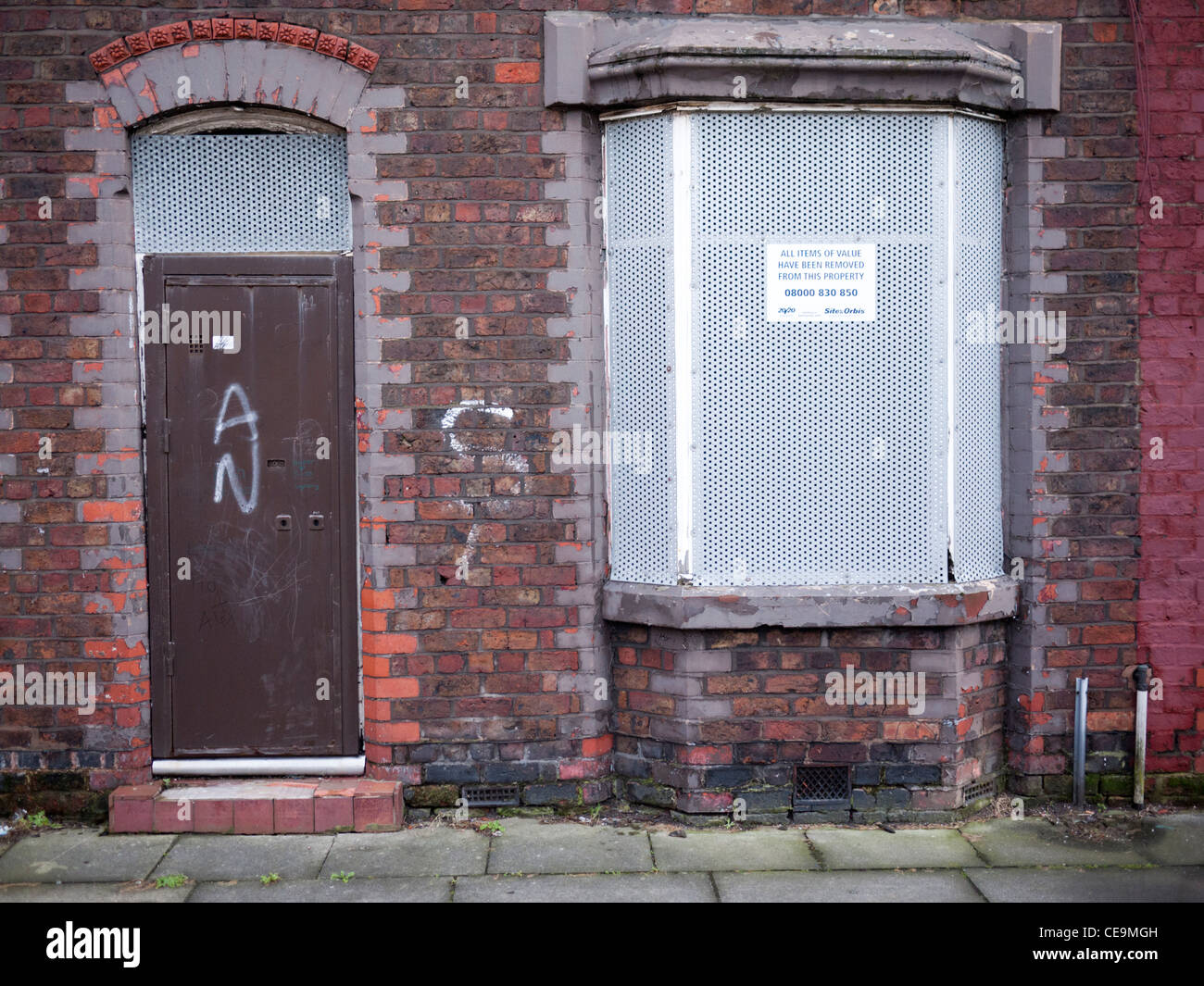 Boarded up terraced house in Liverpool England UK Stock Photo