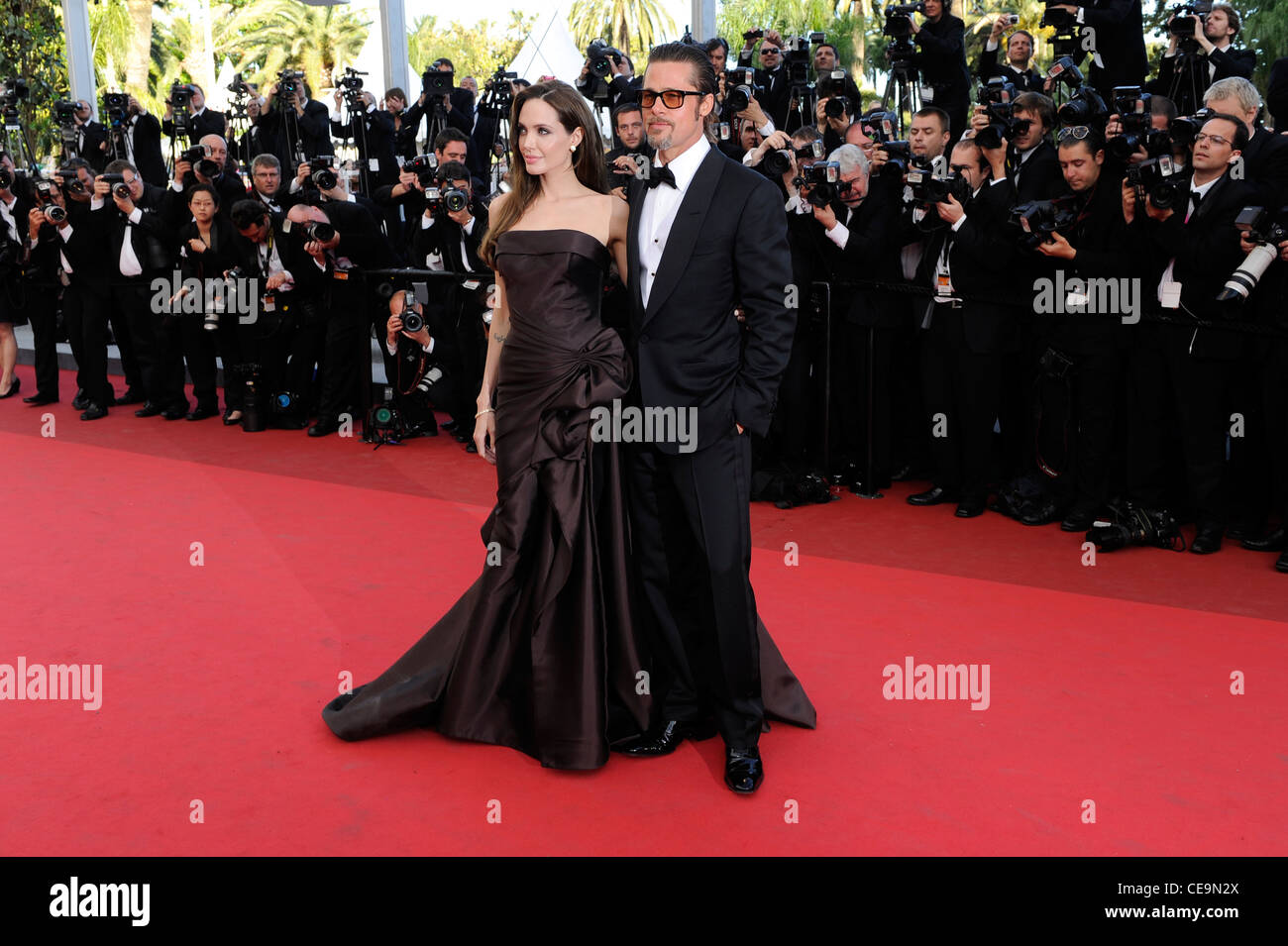 Angelina Jolie and Brad Pitt arrive for the screening of The Tree of Life at the 64th international film festival, Stock Photo