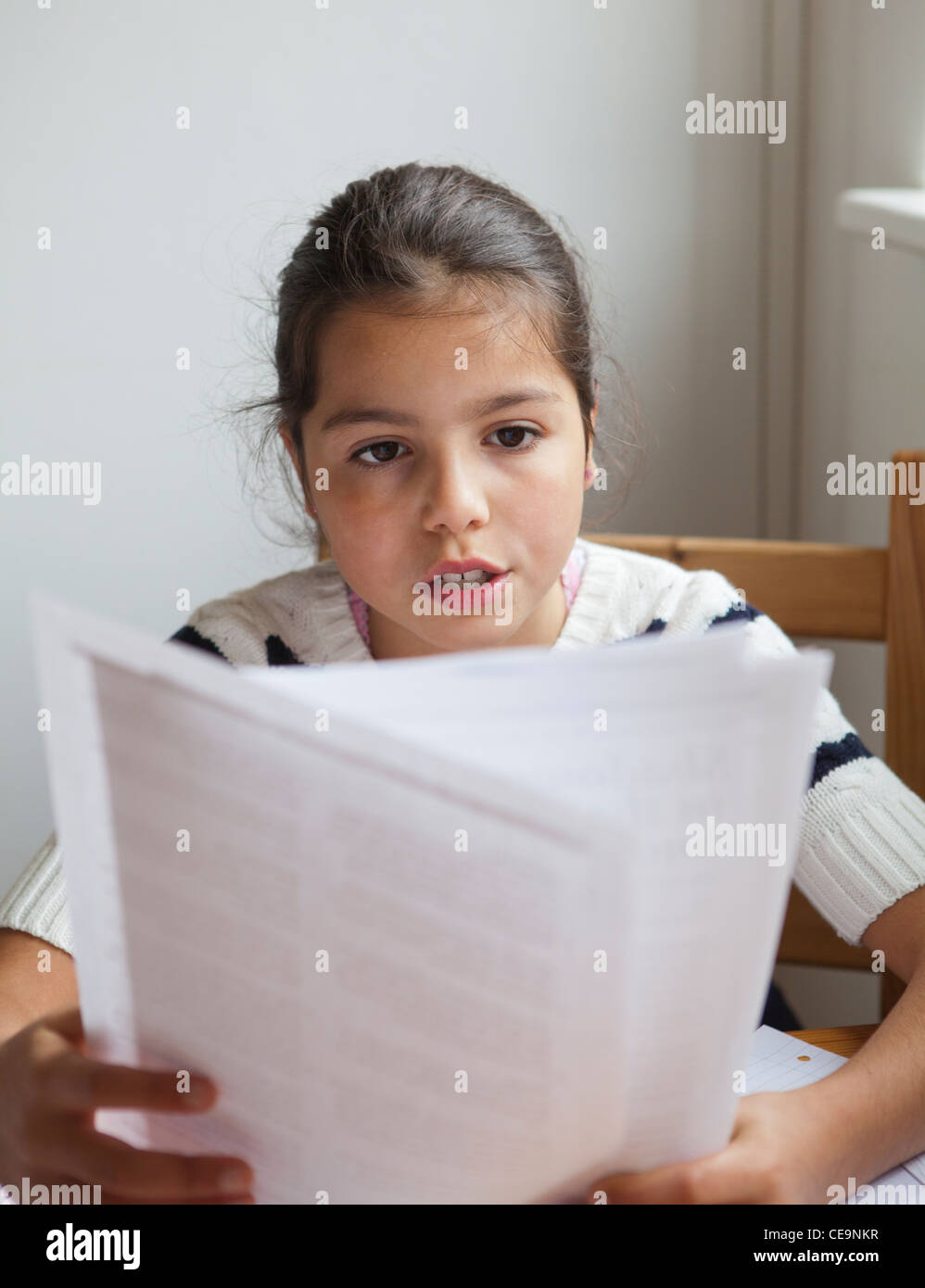 Schoolgirl learning for 11+ exams - Stock Image