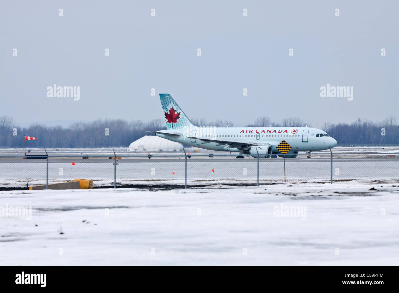 Air Canada plane taxiing on the runway - Stock Image
