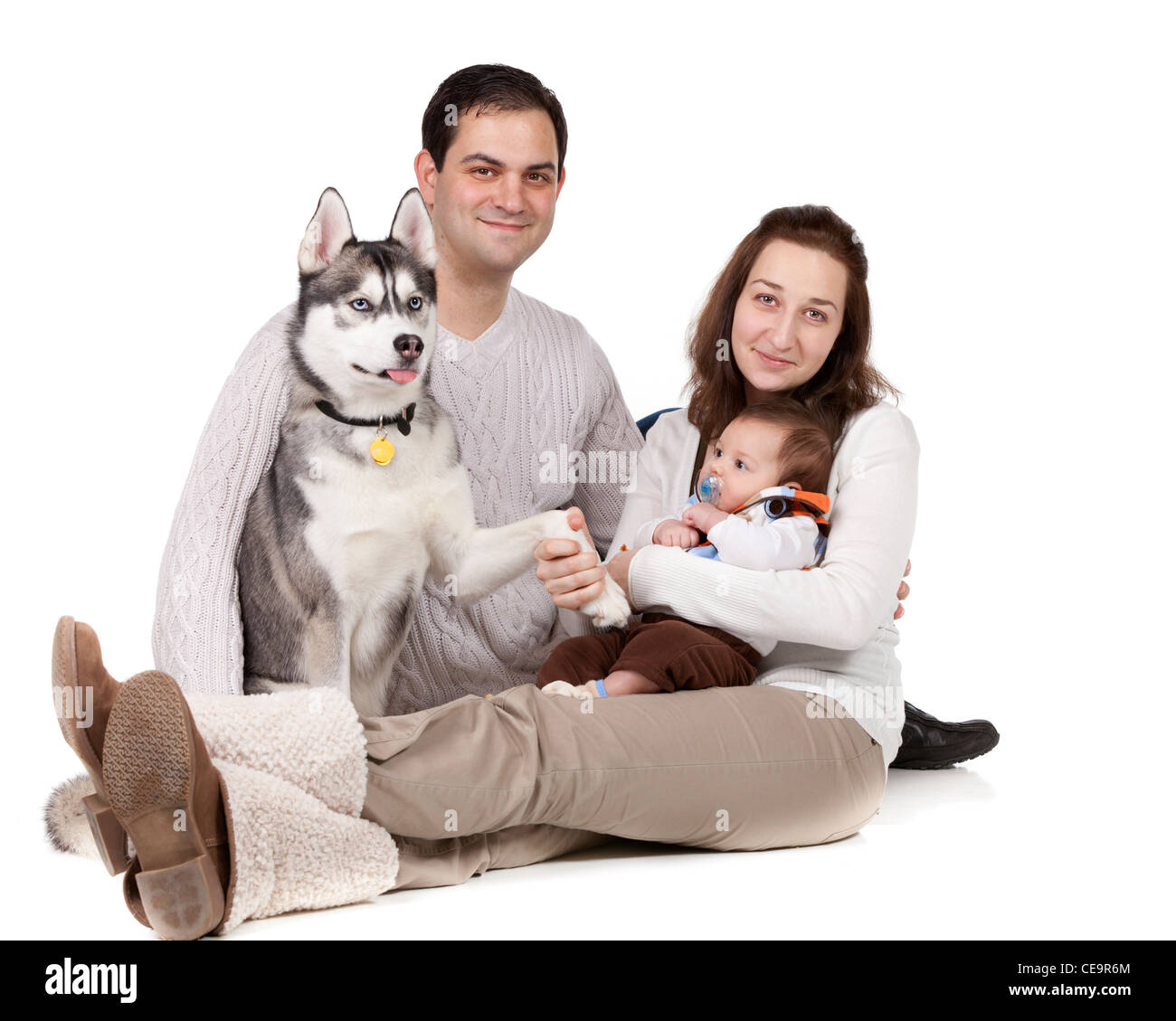 Young Family On White Background