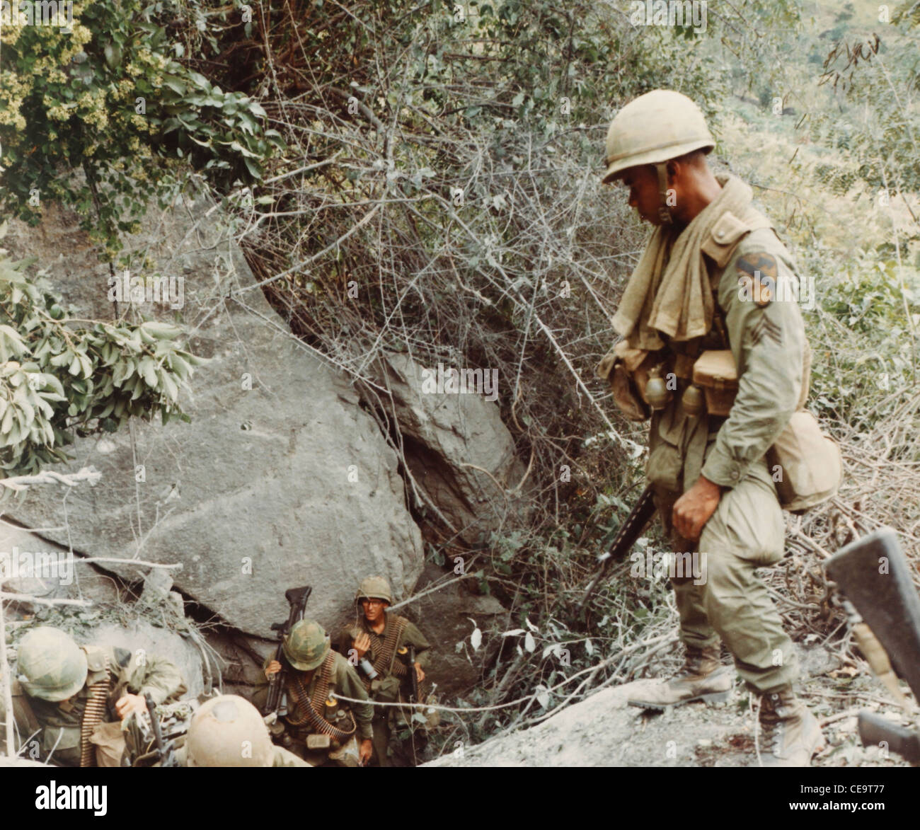 Members of Co B, 2nd Bn, 8th CAV, 1st Cavalry Division climb a mountainside during opertation Pershing search and - Stock Image