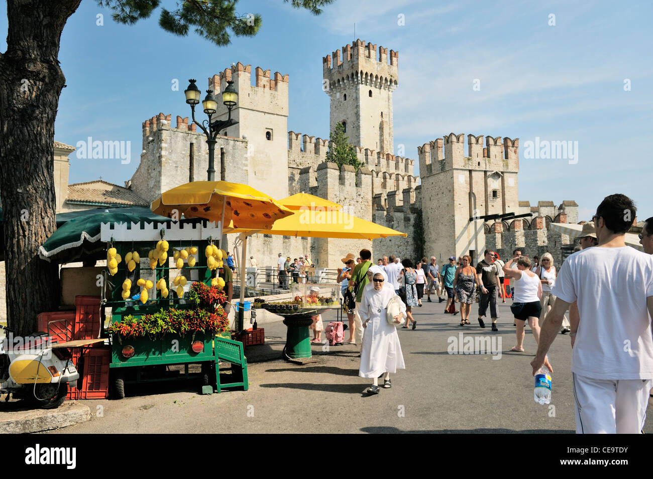 Sirmione on Lake Garda, Lombardy, Italy. Ancient town and tourist centre. The 13 C. Scaliger Castle - Stock Image