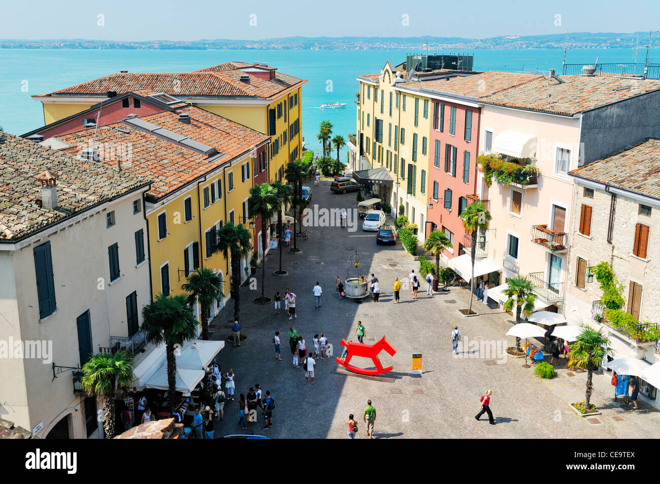 The holiday resort town of Sirmione on Lake Garda, Lombardy, Italy. From the castle over Piazza Castello to Lago - Stock Image