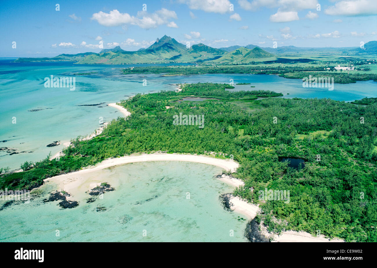 SW over beaches of Isle Aux Cerfs, Beau Rivage, toward Mt. Bambou and Lion Mt. in Domaine du Chasseur, east coast - Stock Image