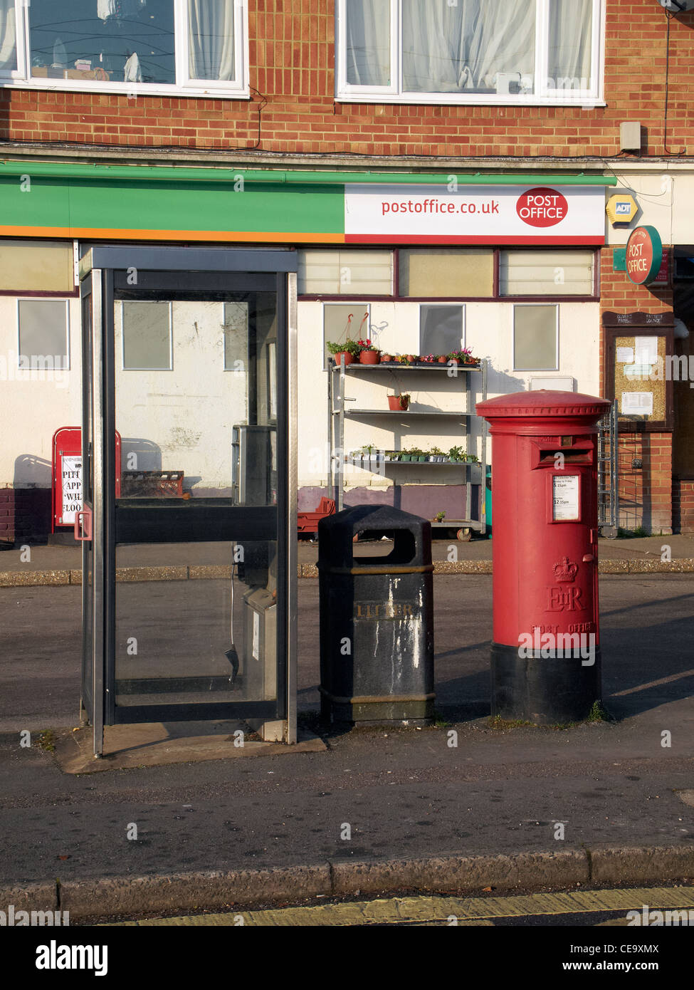 Parade of local shops with phone box, post box and bus shelter, in Olivers Battery a suburb of Winchester, Hampshire,. Stock Photo