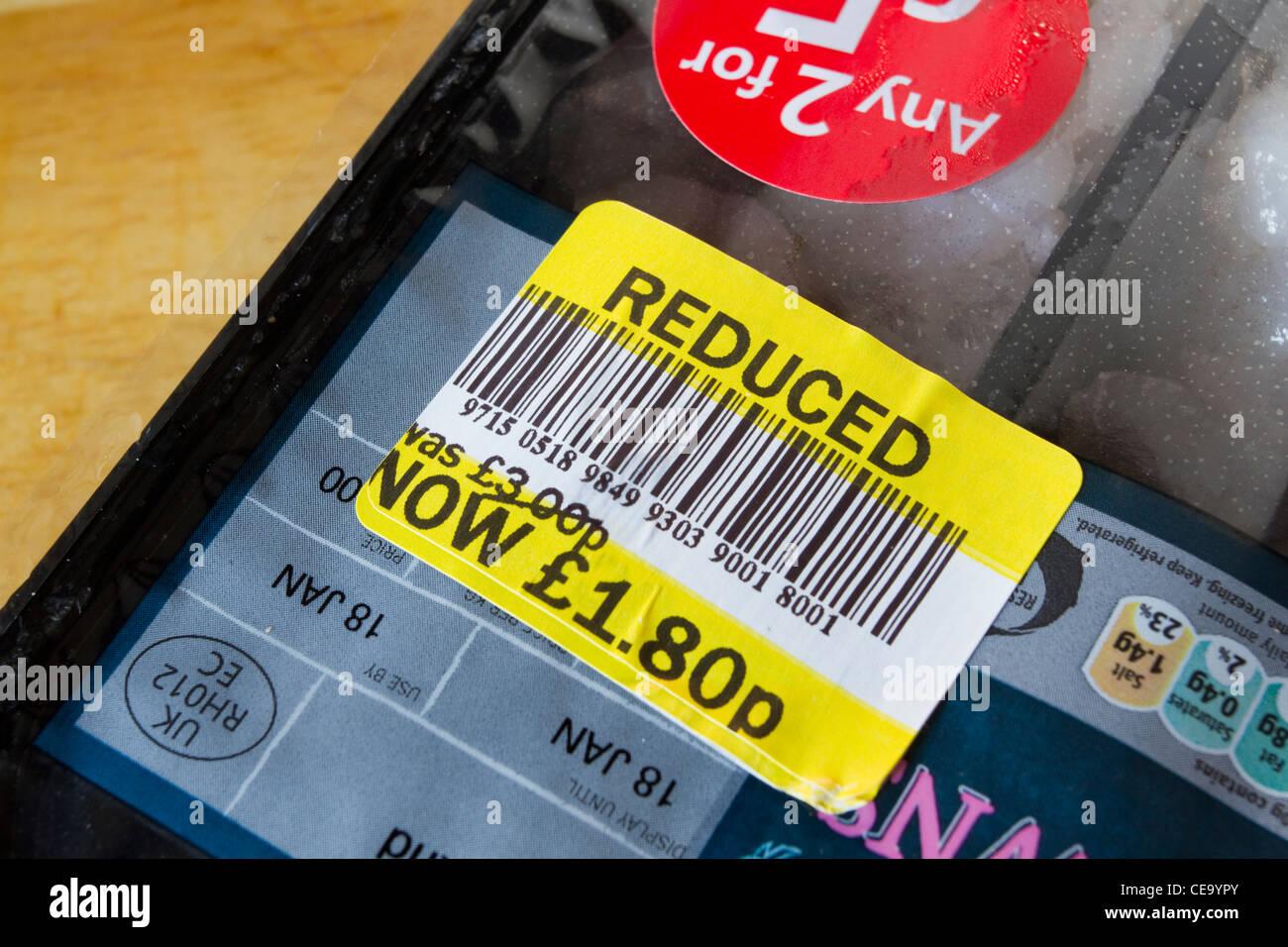 Sainsburys supermarket reduced food discount sticker.  England, UK - Stock Image