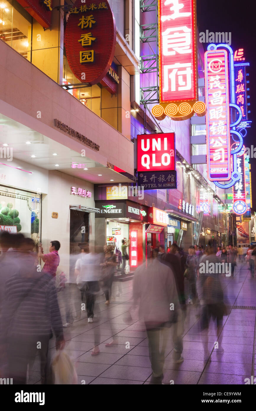 Neon lights and shops along Nanjing Rd; Shanghai; China - Stock Image