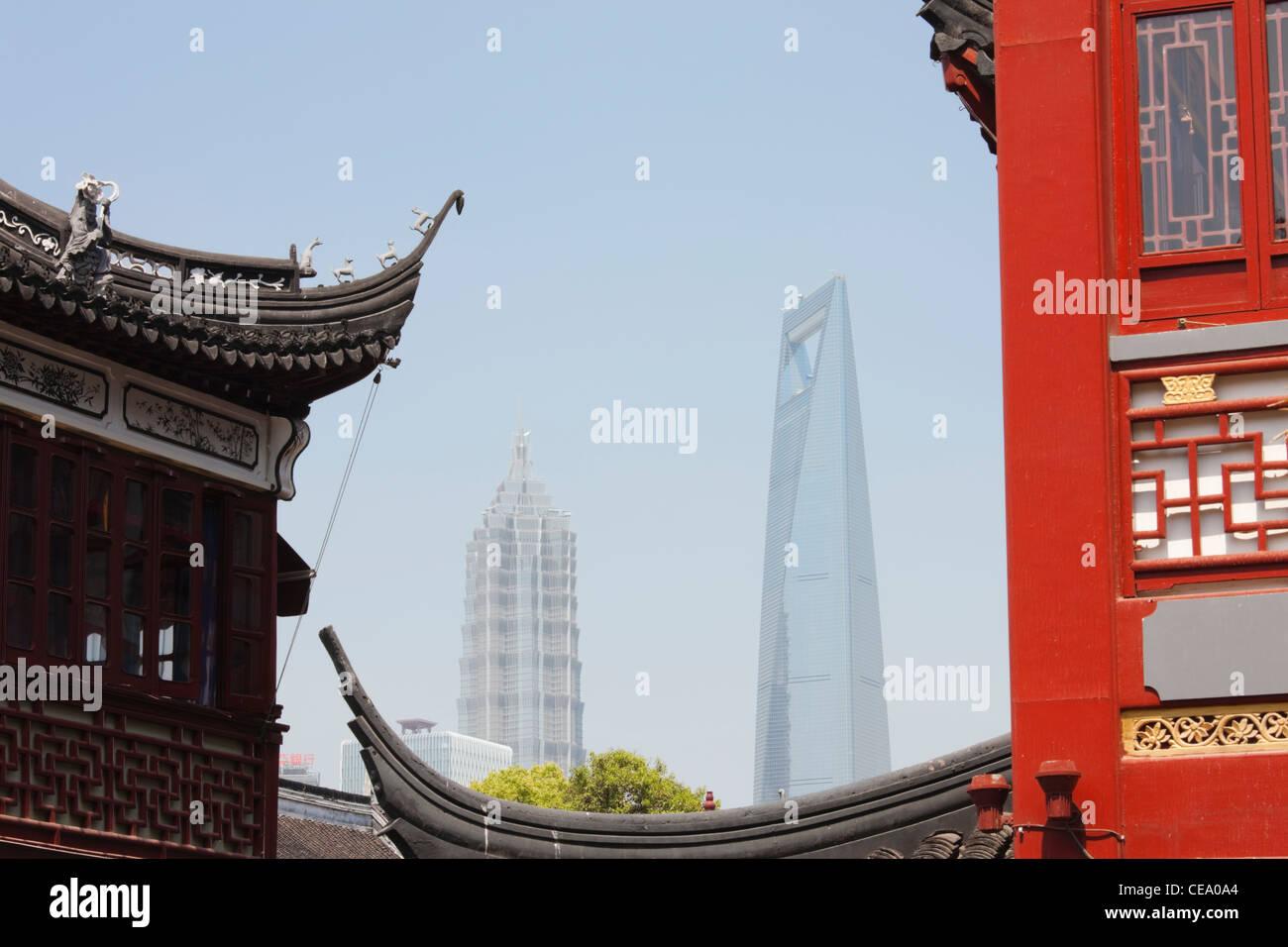 Jin Mao Tower and Shanghai World Financial Centre through buildings of Yu Gardens Bazaar; Yuyuan; Shanghai; China - Stock Image
