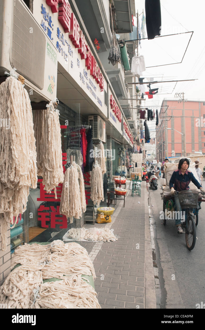 Cloth and textile industry, Old Town; Shanghai; China - Stock Image