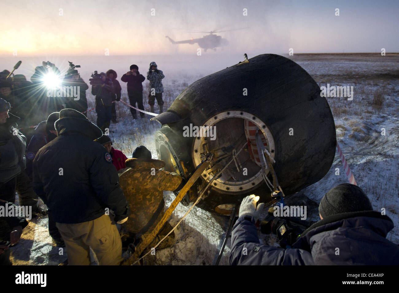 Expedition 29 Crew Lands Russian support personnel work to help get crew members out of the Soyuz TMA-02M spacecraft Stock Photo