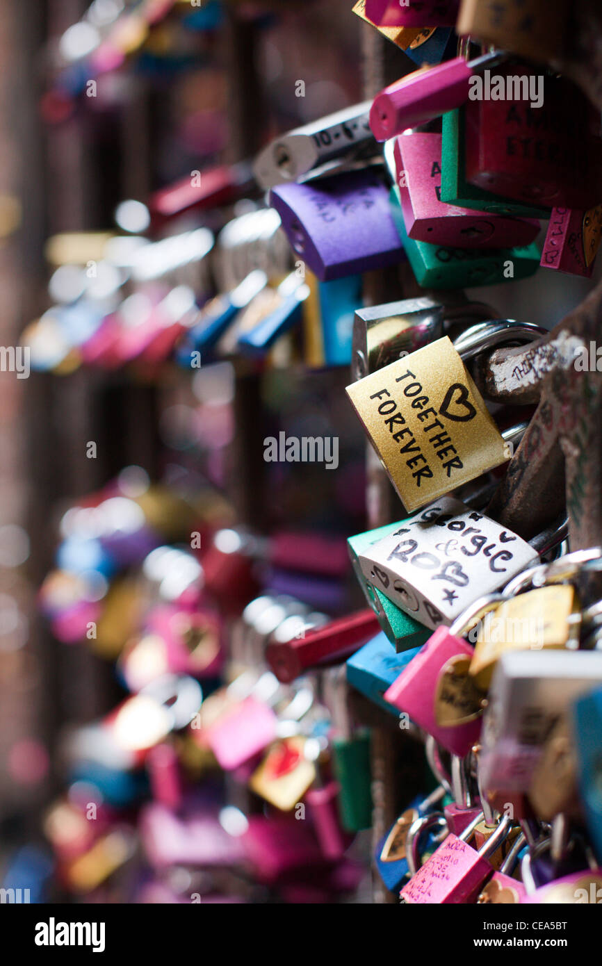 Love padlocks with 'Together Forever' written on one, in the courtyard below Romeo & Juliet's balcony. - Stock Image