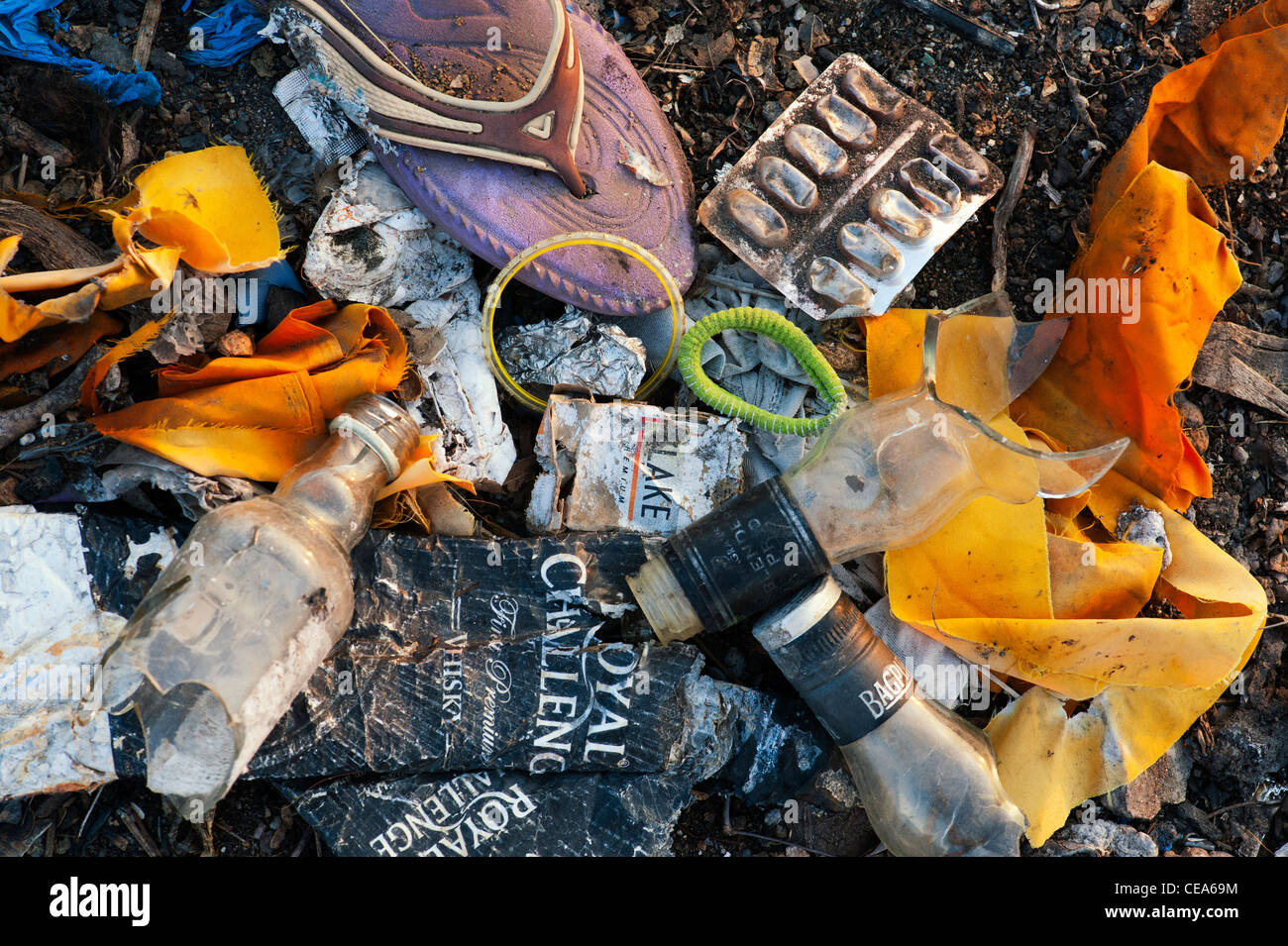 Discarded household waste in the Indian countryside, representing the concept of Indian family social issues. Andhra Pradesh, India Stock Photo