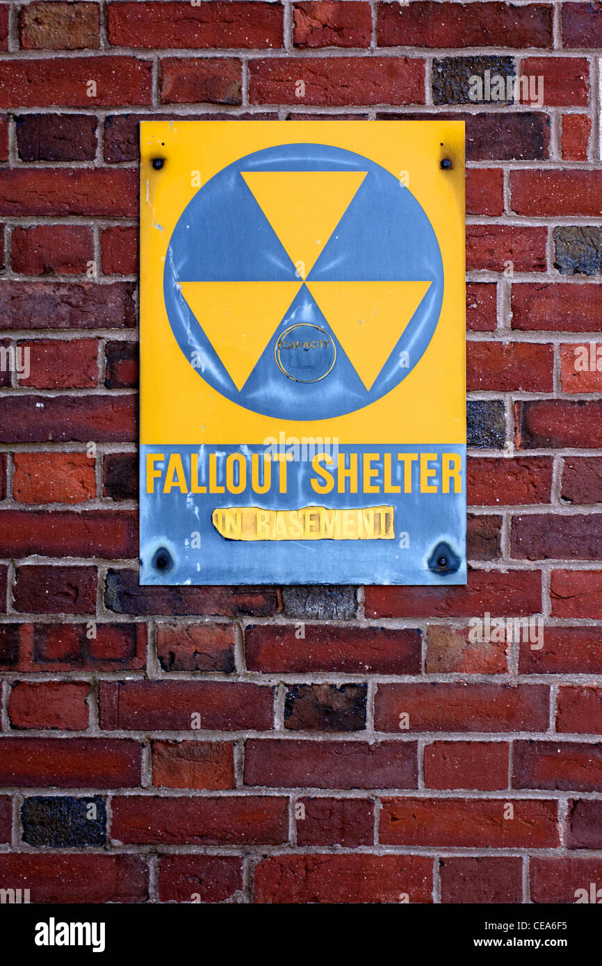 A weathered sign announcing a fallout shelter on an abandoned building on the Eastern seaboard of the USA. - Stock Photo