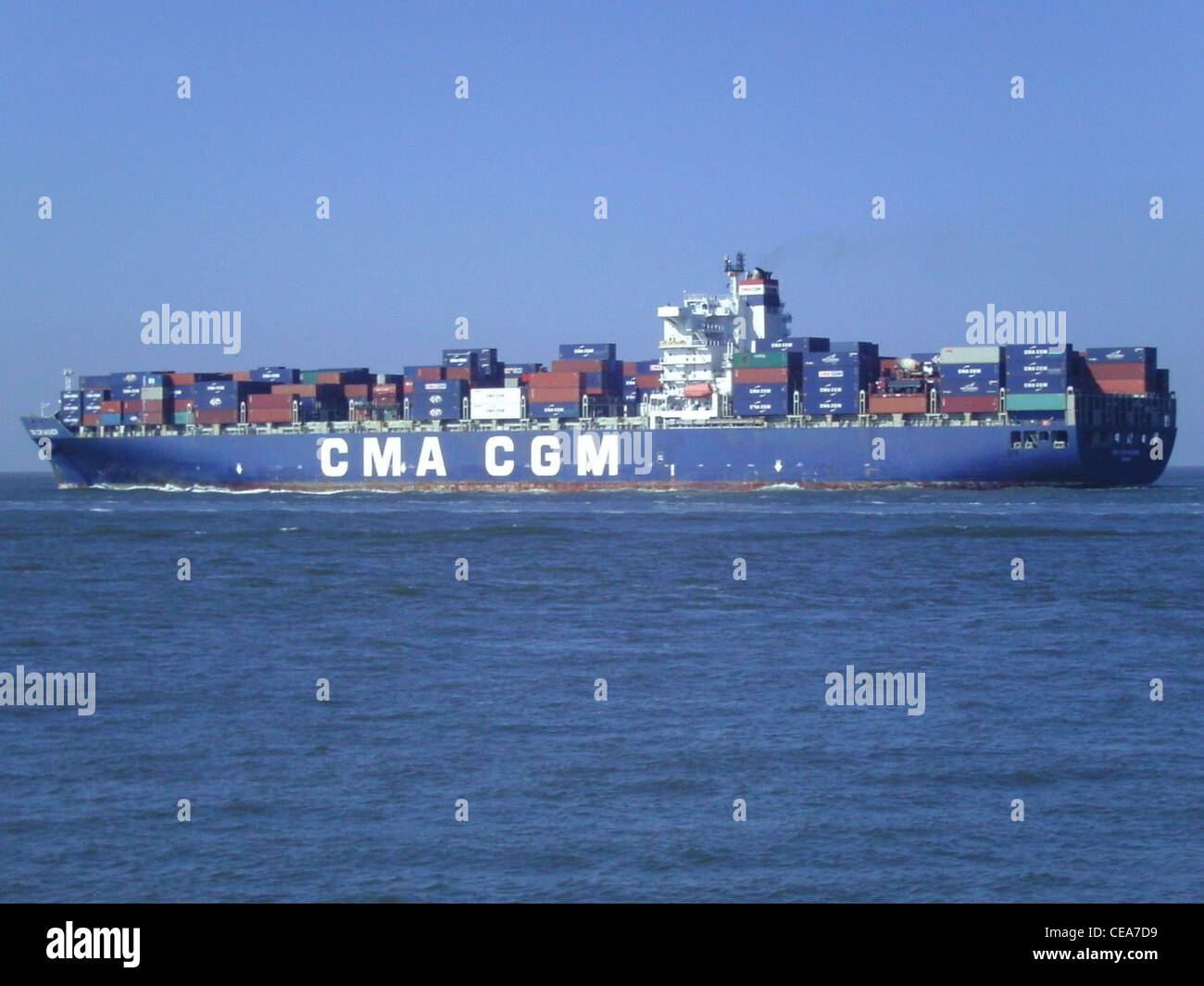 The container ship CMA CGM Wagner from the French shipping company CGA CGM outbound on the River Elbe near Cuxhaven - Stock Image