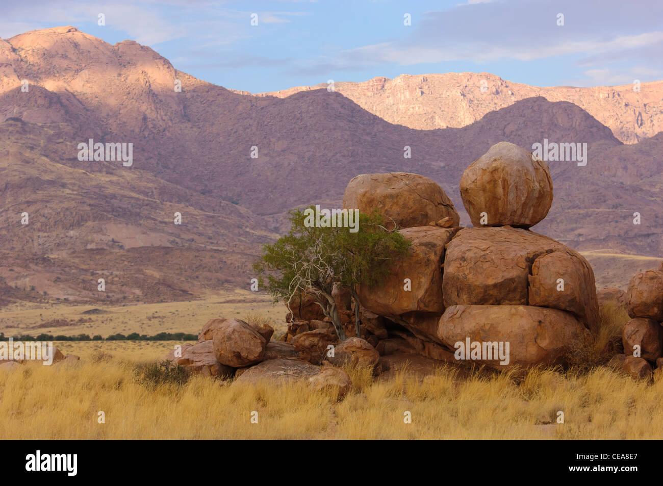 Rounded rocks on the plain near the Brandberg. Damaraland, Namibia - Stock Image