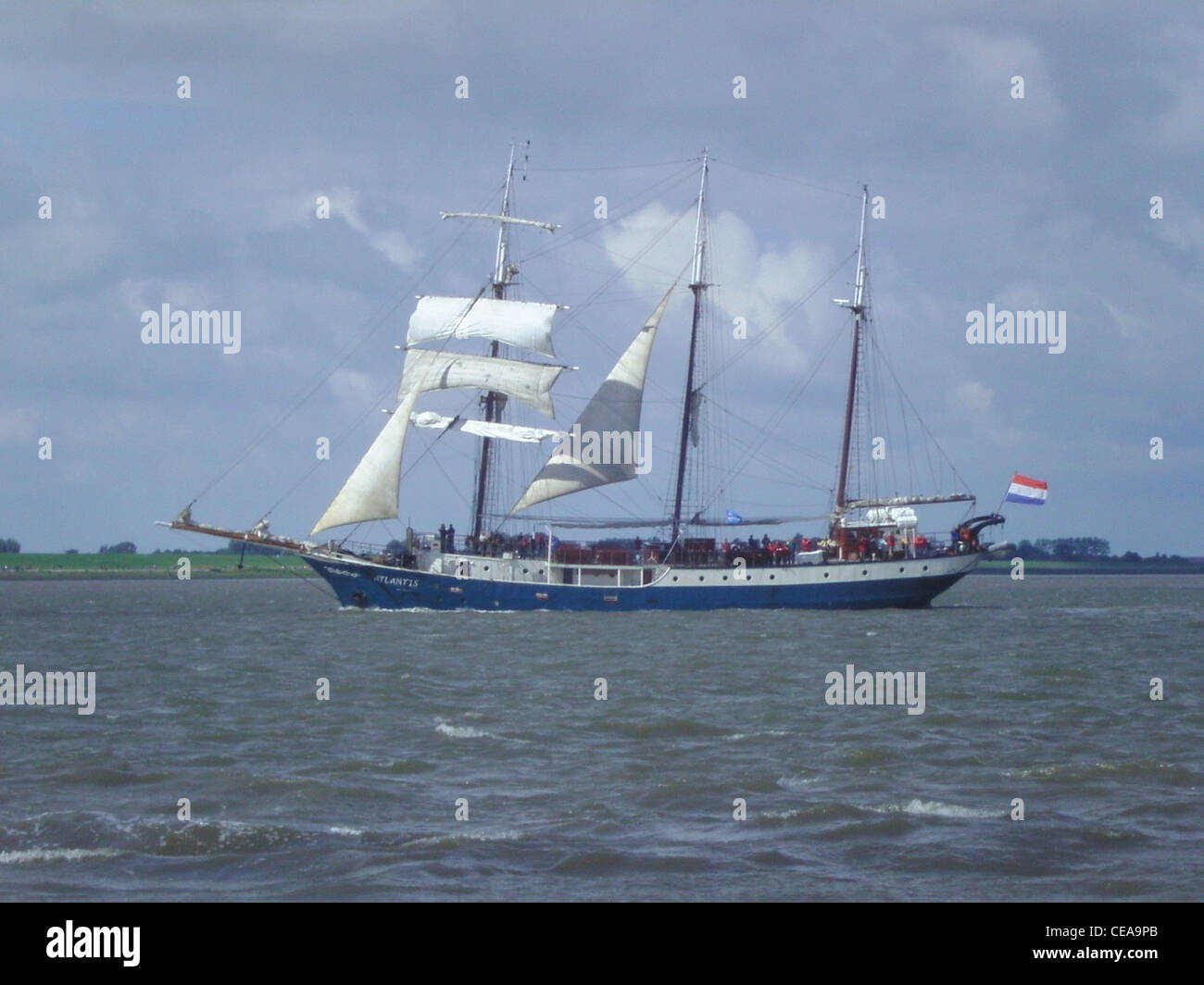 The Dutch sailing ship Atlantis in a parade on the River Weser in front of Bremerhaven - Stock Image