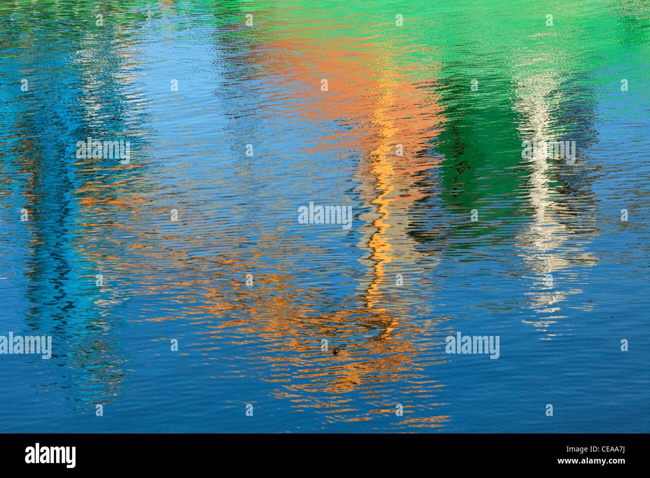 Reflections of a ship loading at Blythe Quay make for a brightly colored abstract - Stock Image