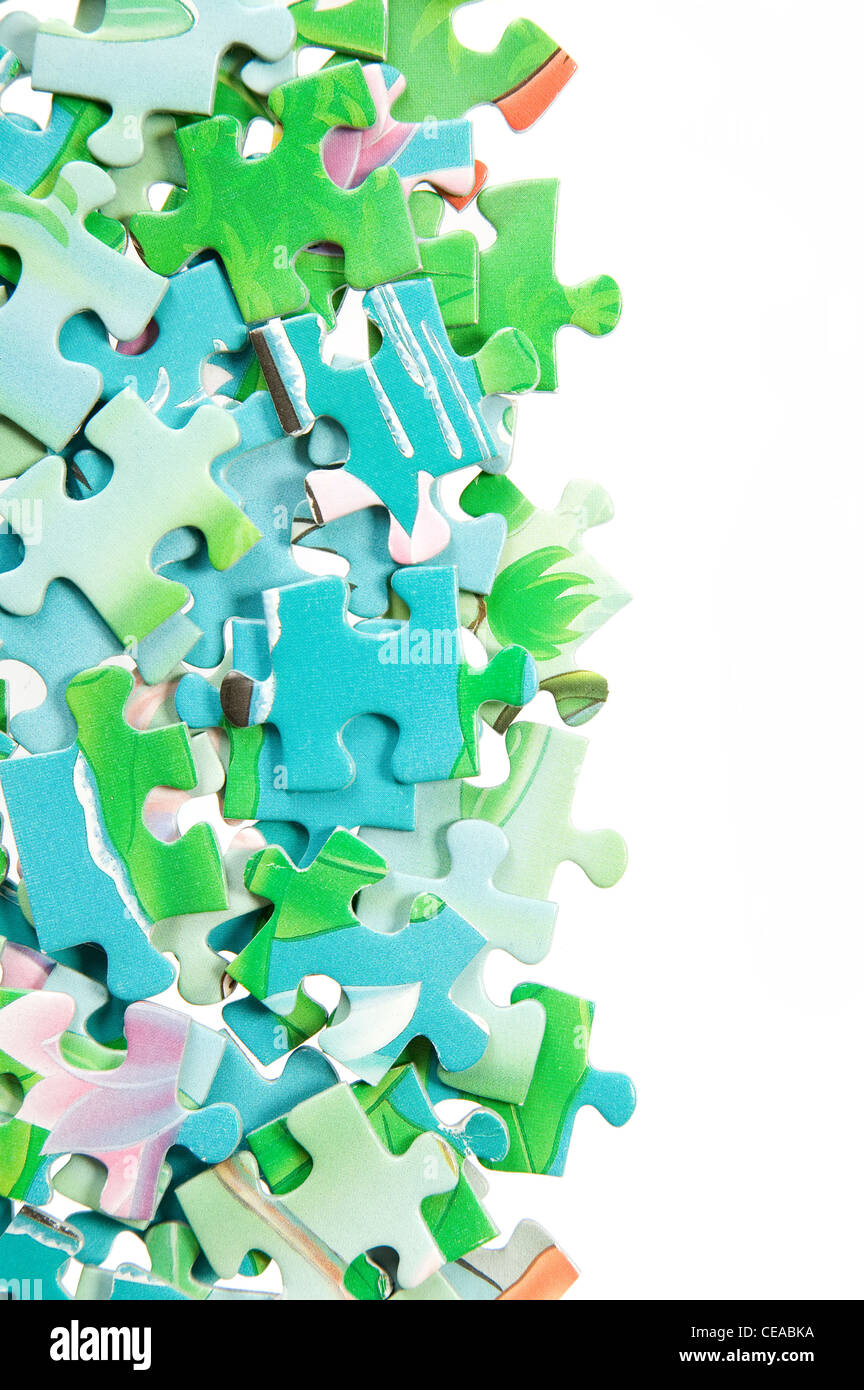 There are many colorful puzzle in various shapes - Stock Image
