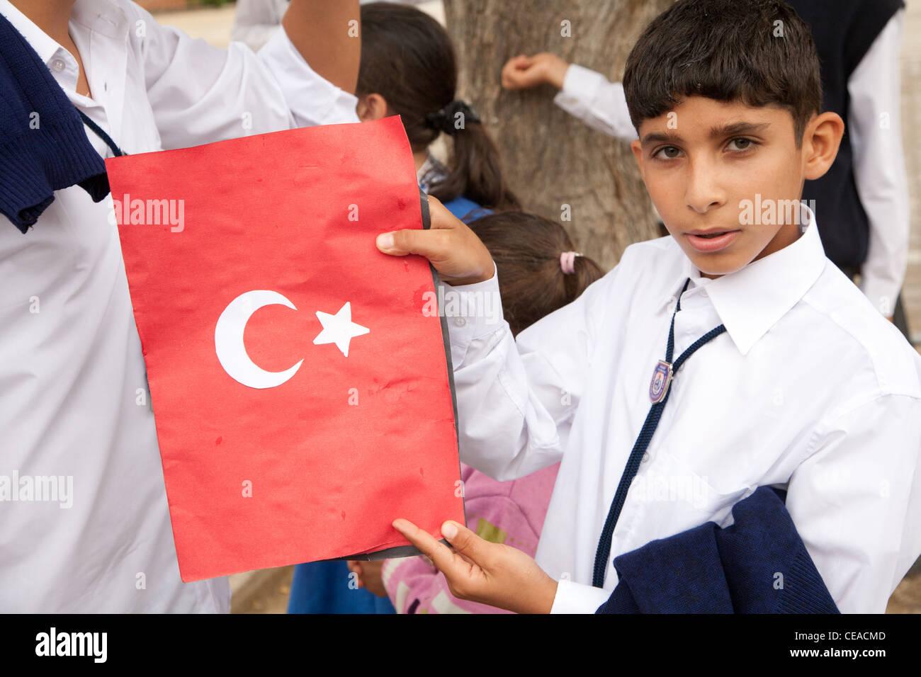 Happy Turkish schoolchildren celebrate Turkish Republic Day in Tekirova town, Turkey  on 29 October, 2010 - Stock Image