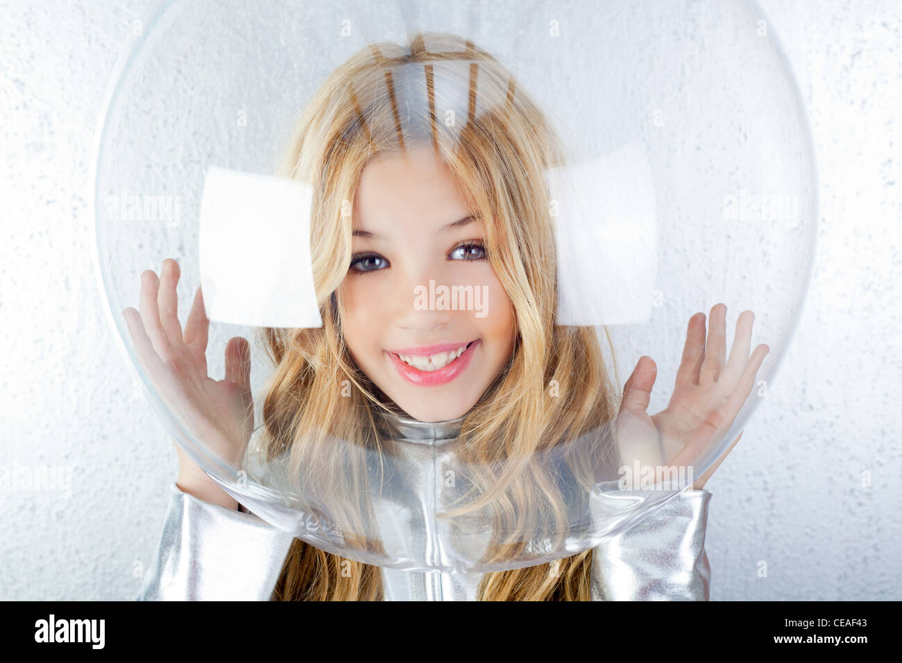 futuristic little girl with space suit - Stock Image
