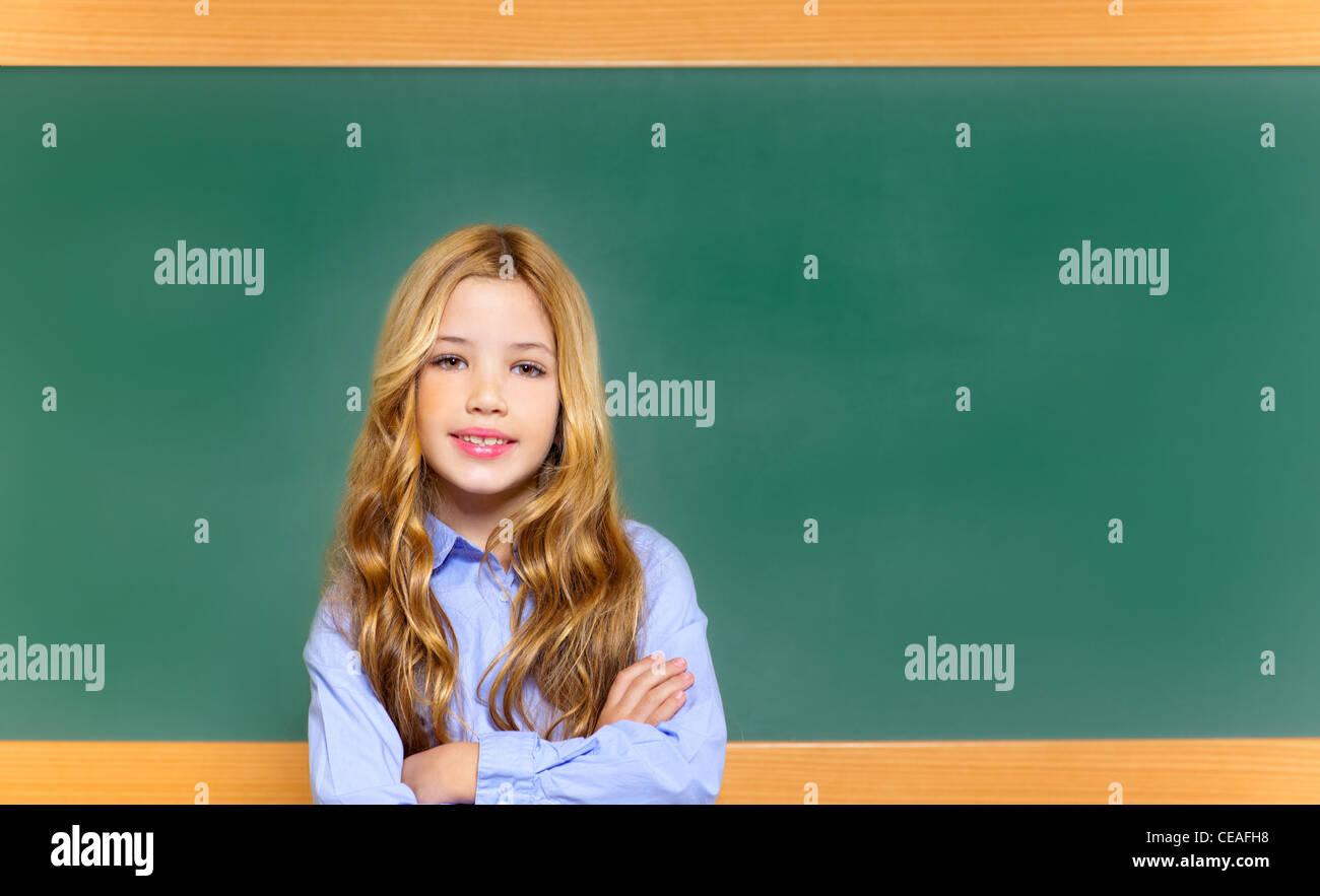 beautiful little girl in blackboard school - Stock Image