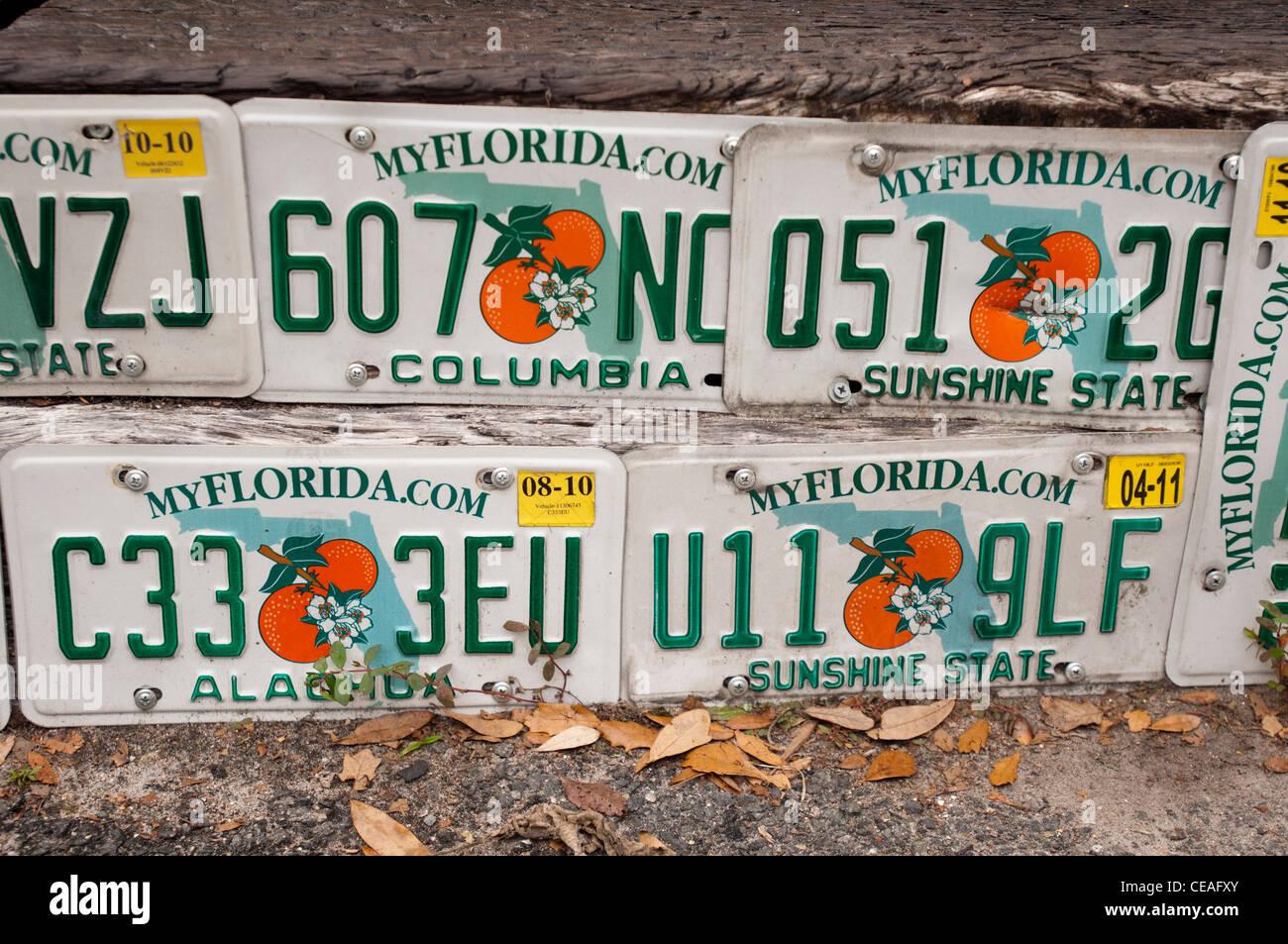 Five unused car license plates in Gainesville, Florida, oranges, white, green - Stock Image