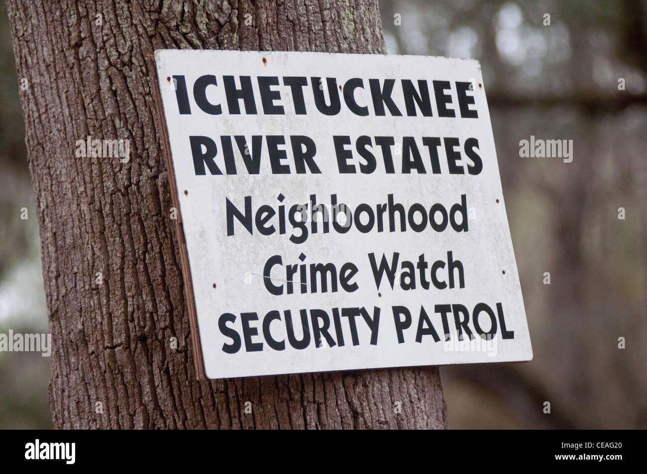 Ichetucknee river estates Neighborhood Crime Watch Security Patrol sign, Florida, United States, USA, tree - Stock Image