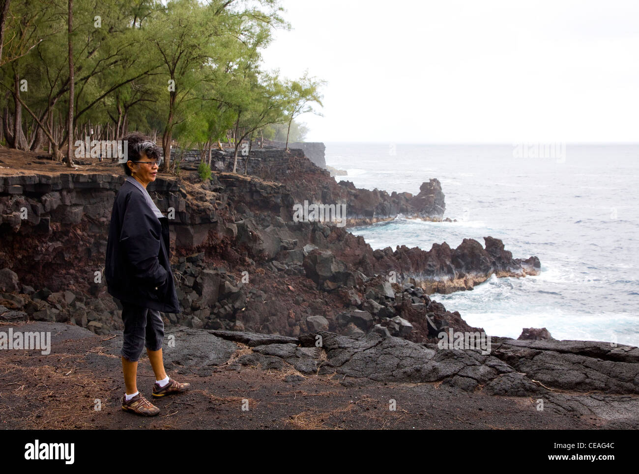 Lava meets the sea at Kapoho Point on Big Island's volcanically active Cape Kumukahi, the easternmost point - Stock Image