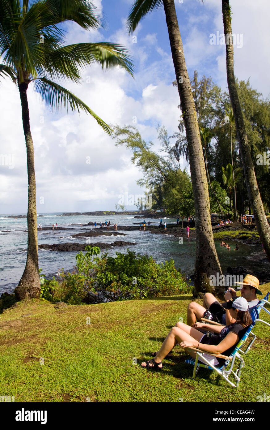 Fronting Hilo Bay, Onekahakaha Beach Park is popular with surfers, swimmers and sunbathers, Hilo, Big Island, Hawaii - Stock Image