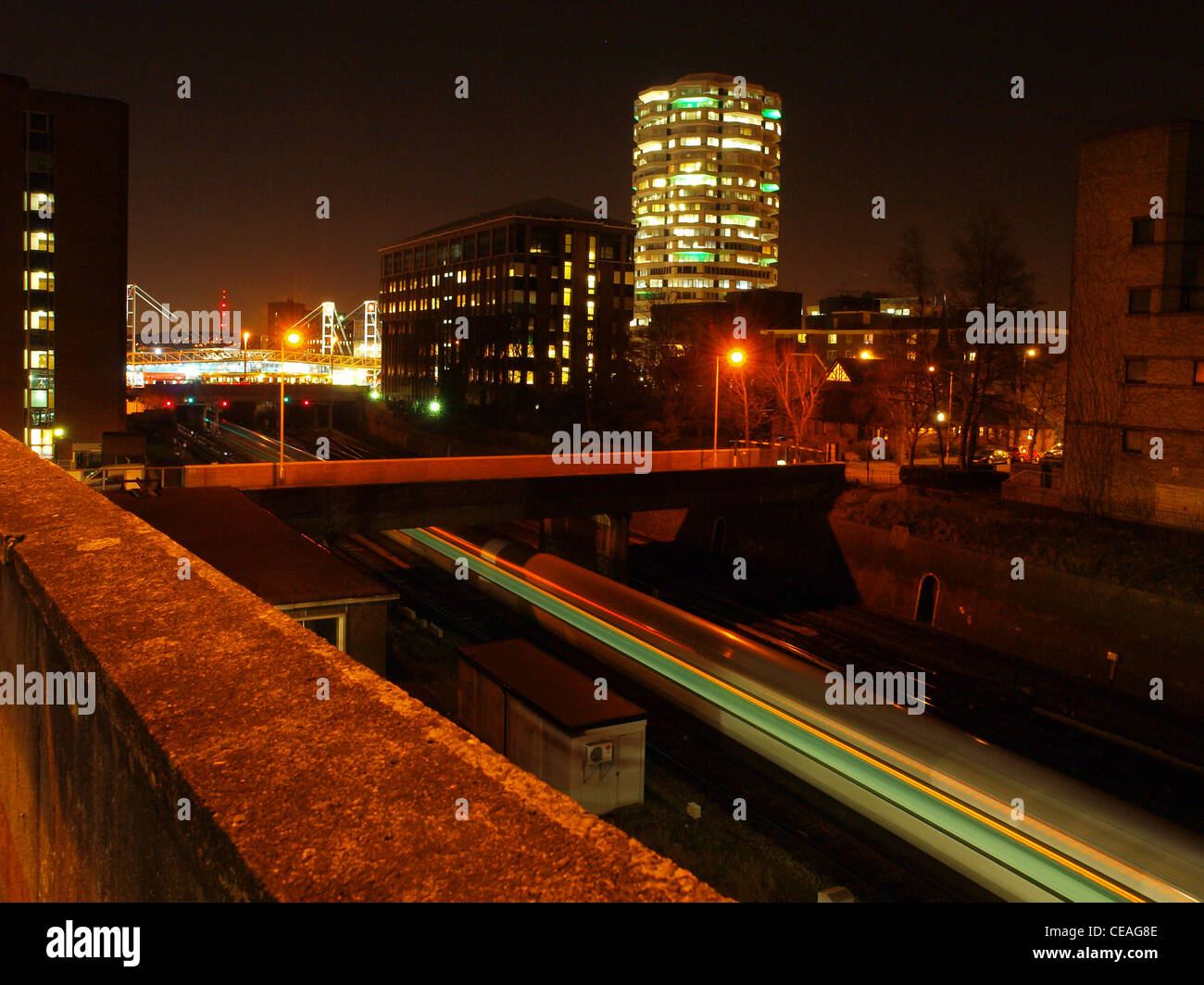 A train speeds past just south of East Croydon Station. - Stock Image
