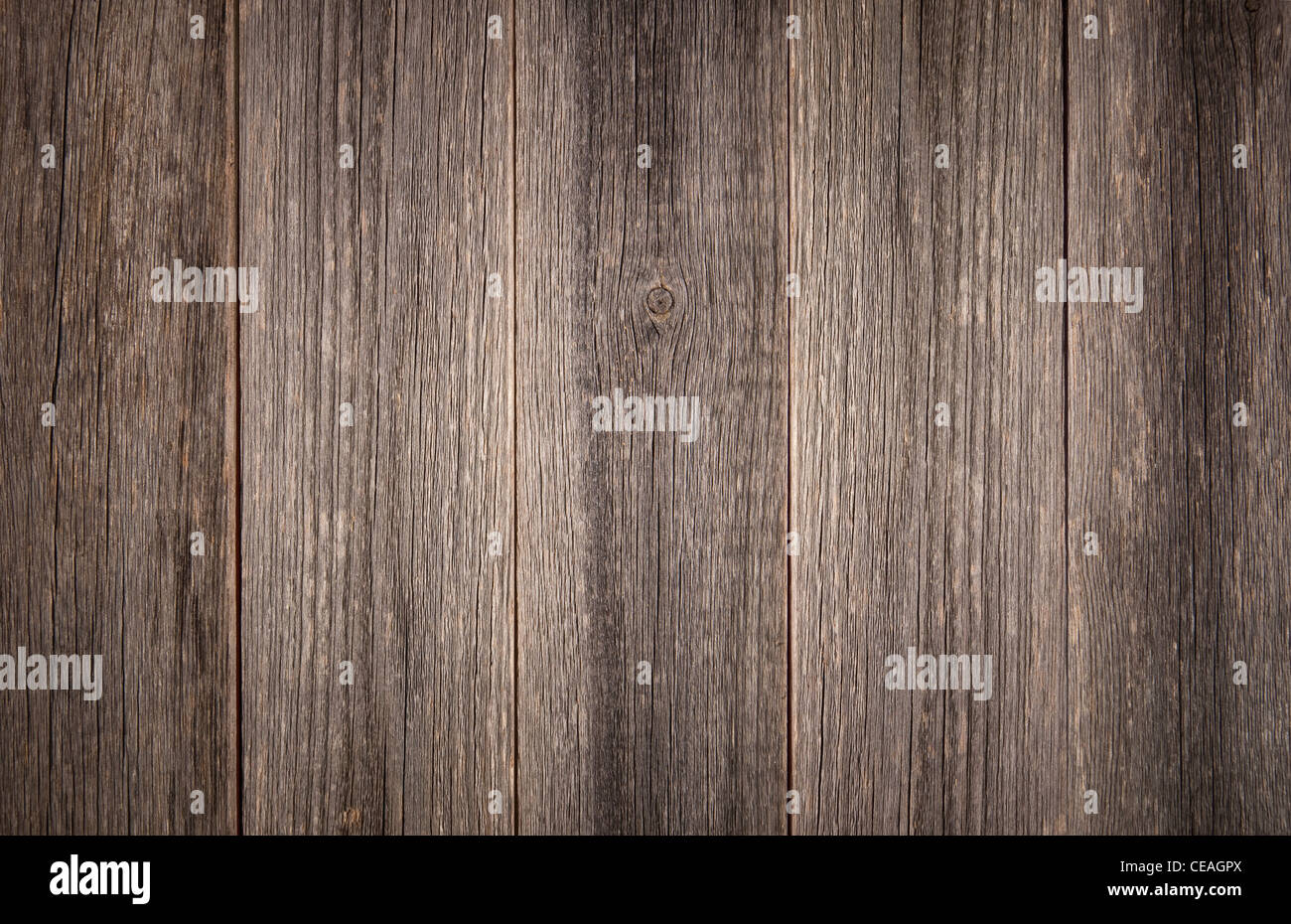 Weathered grey background detail of vertical barn wood boards. - Stock Image