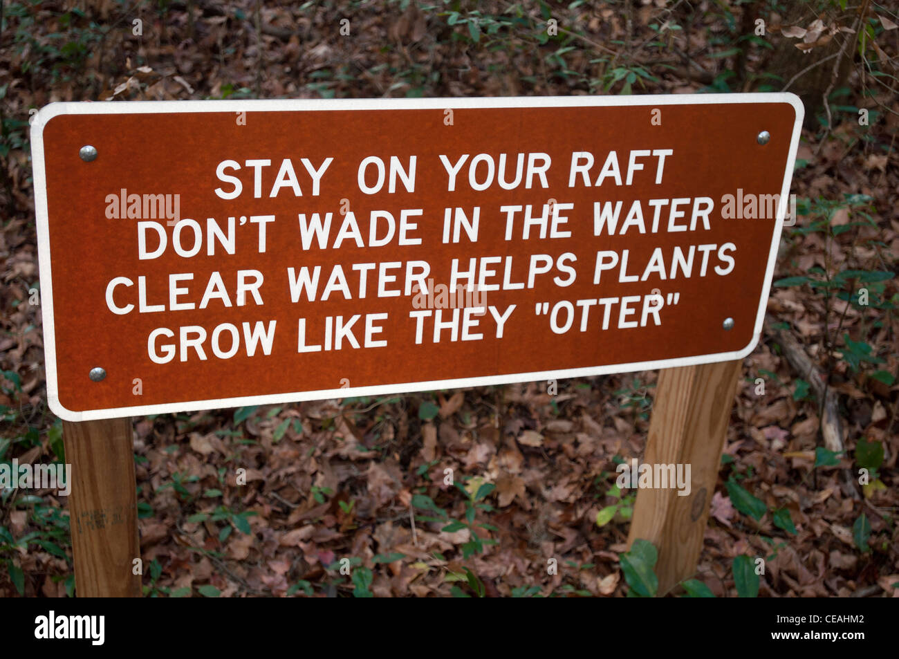 Stay on your raft. Don't wade in the water. Clear water helps plants. Grow like they otter, sign Ichetucknee - Stock Image