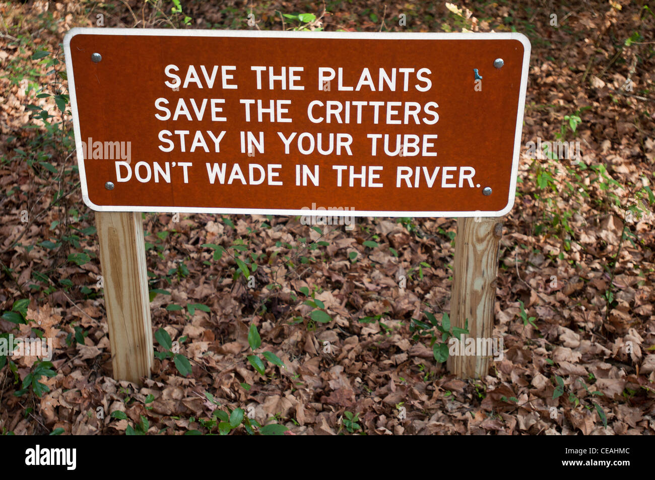 Save the plants. Save the critters. Stay in your tube, Don't wade in the river, sign, Ichetucknee Springs State - Stock Image