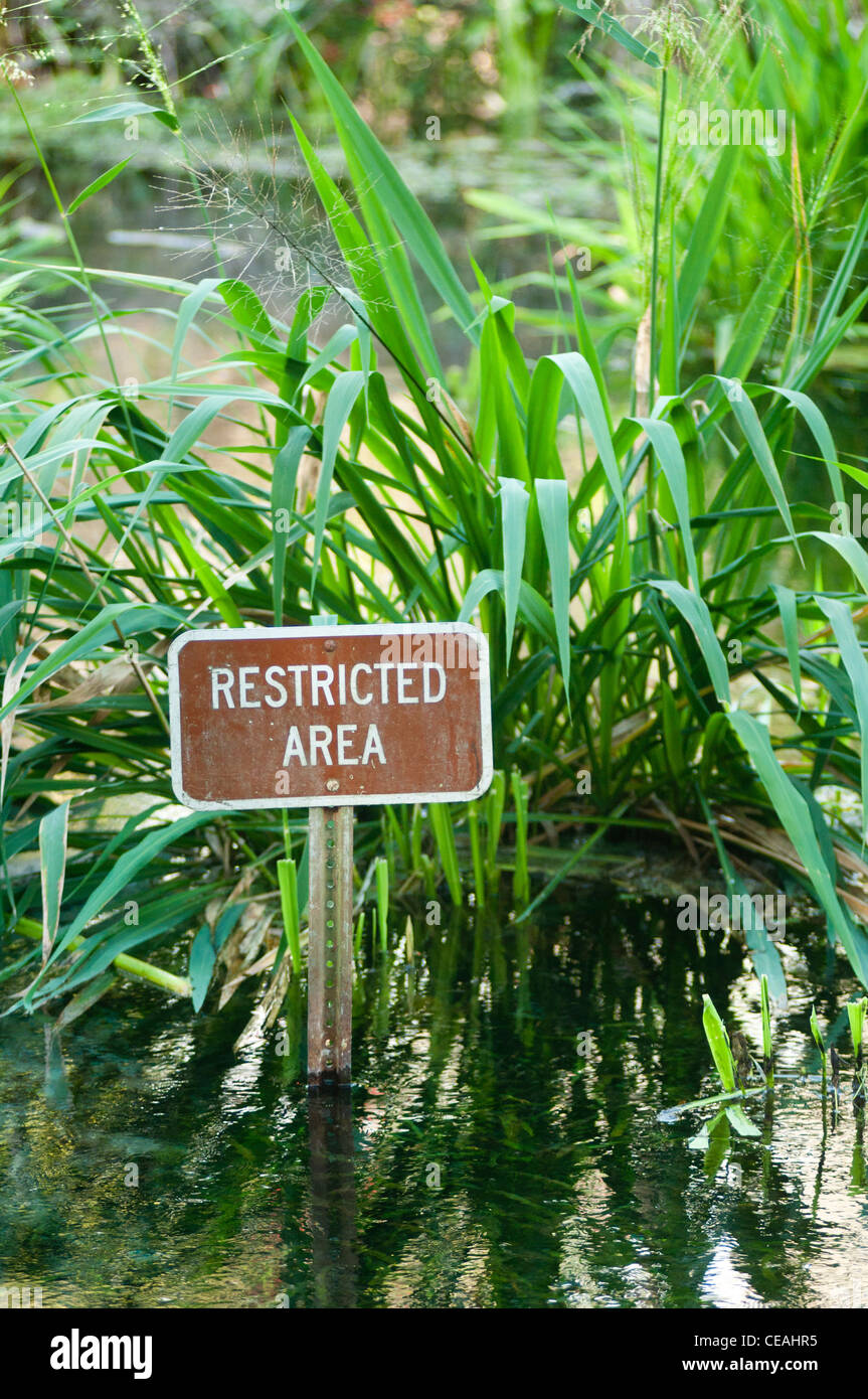 Restricted area sign in water, Ichetucknee Springs State Park, Florida, North America, USA - Stock Image