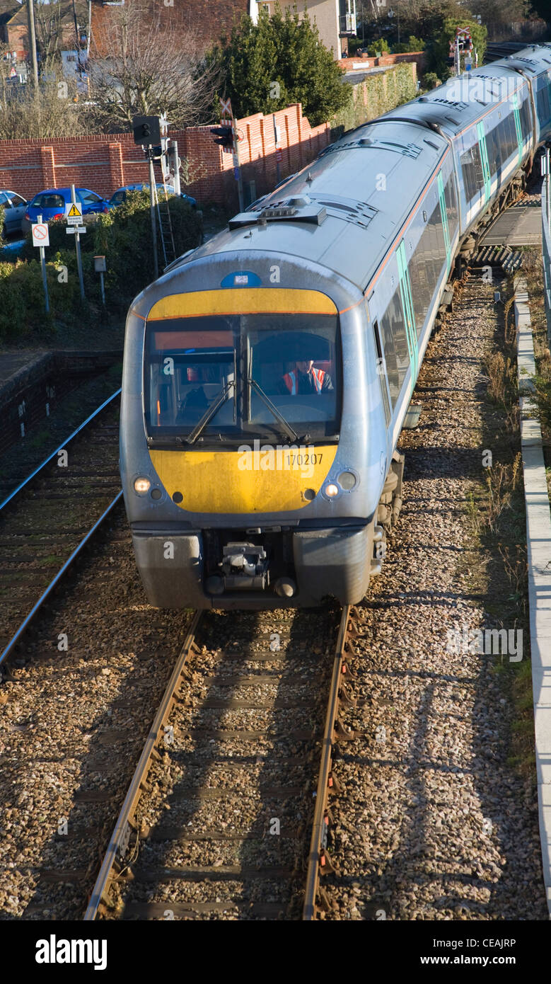 Diesel train and carriages railway lines approaching Woodbridge, Suffolk, England - Stock Image