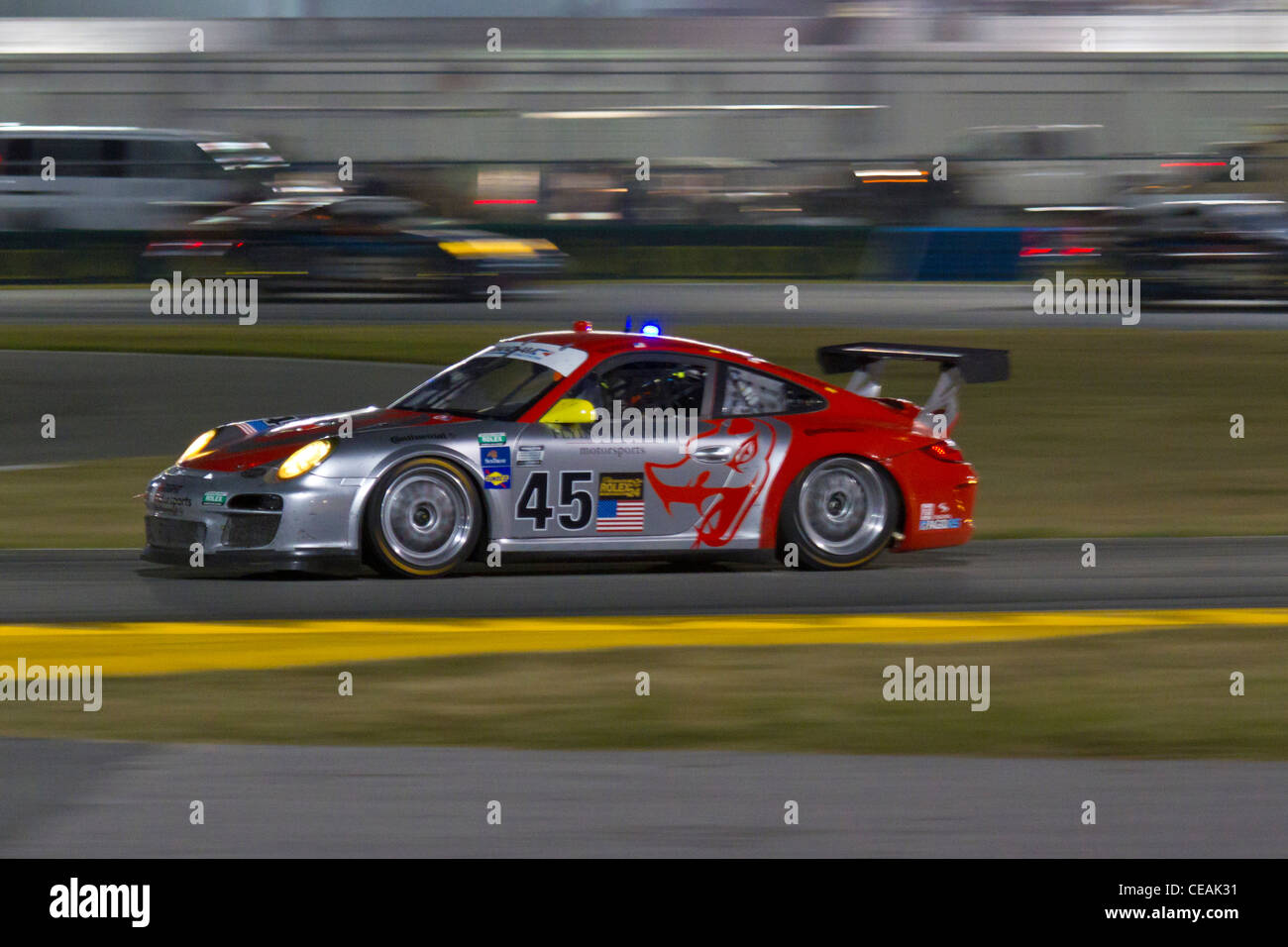 The No. 45 Flying Lizard Motorsports Porsche GT racing in the 50th Anniversary 2012 Rolex 24 At Daytona - Stock Image