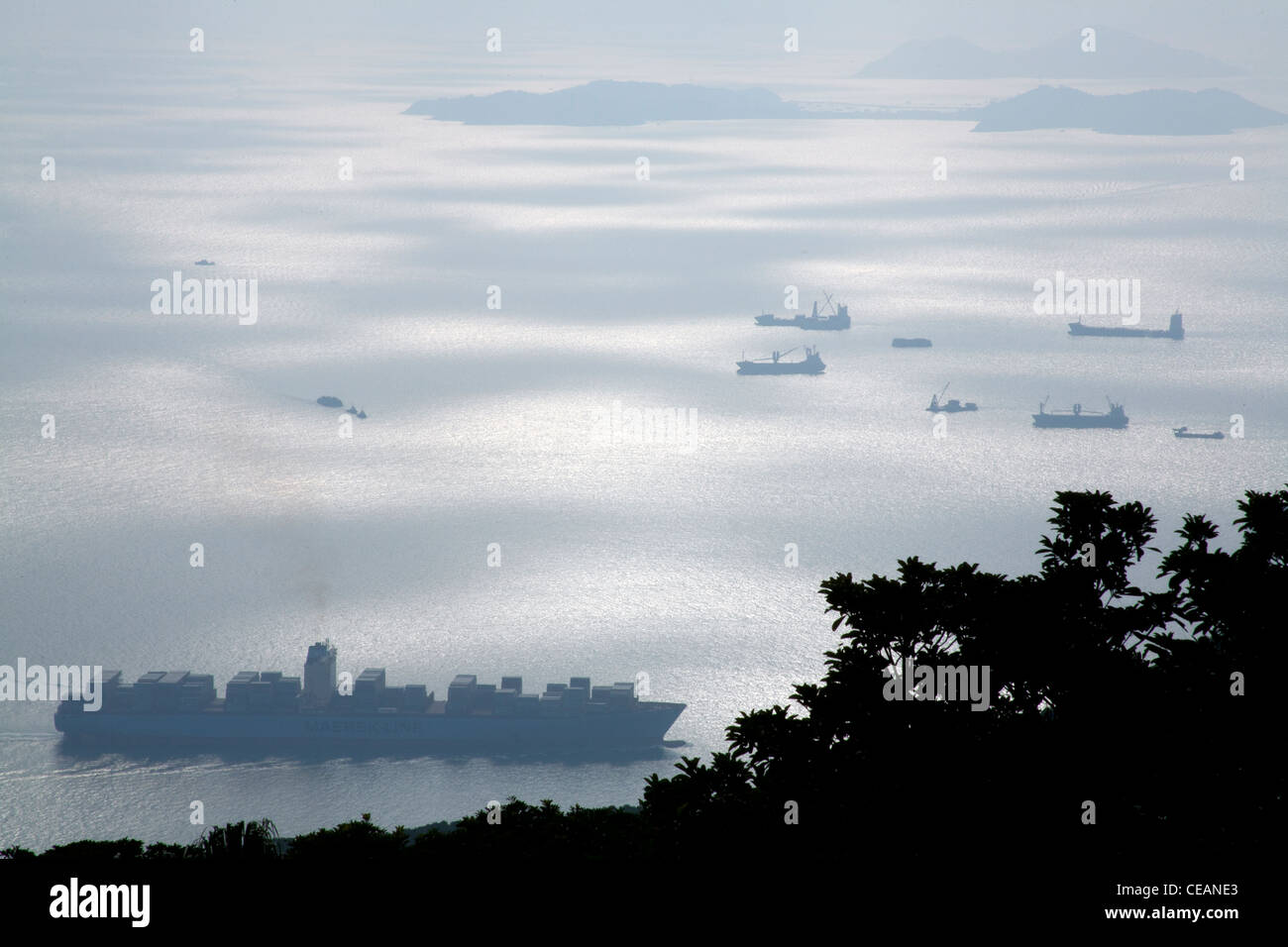 Shipping in the South China sea seen from the garden of the governor's summer residence Victoria Peak Hong Kong - Stock Image