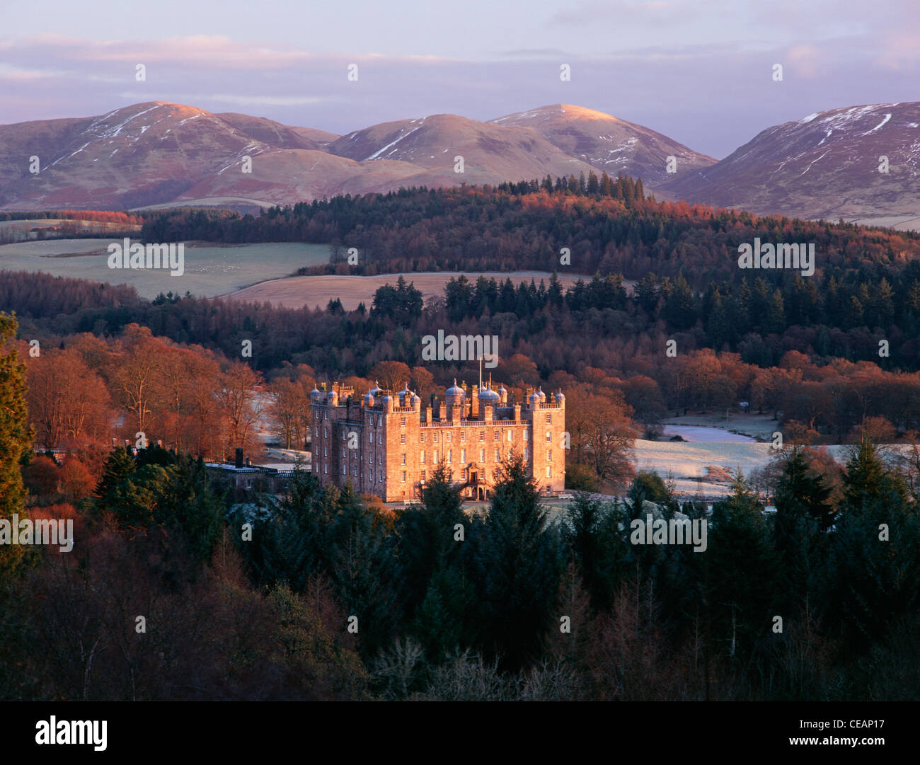 Sunrise winter snow on the Lowther Hills behind Drumlanrig Castle in scenic landscape of the Nith Valley, Nithsdale, - Stock Image