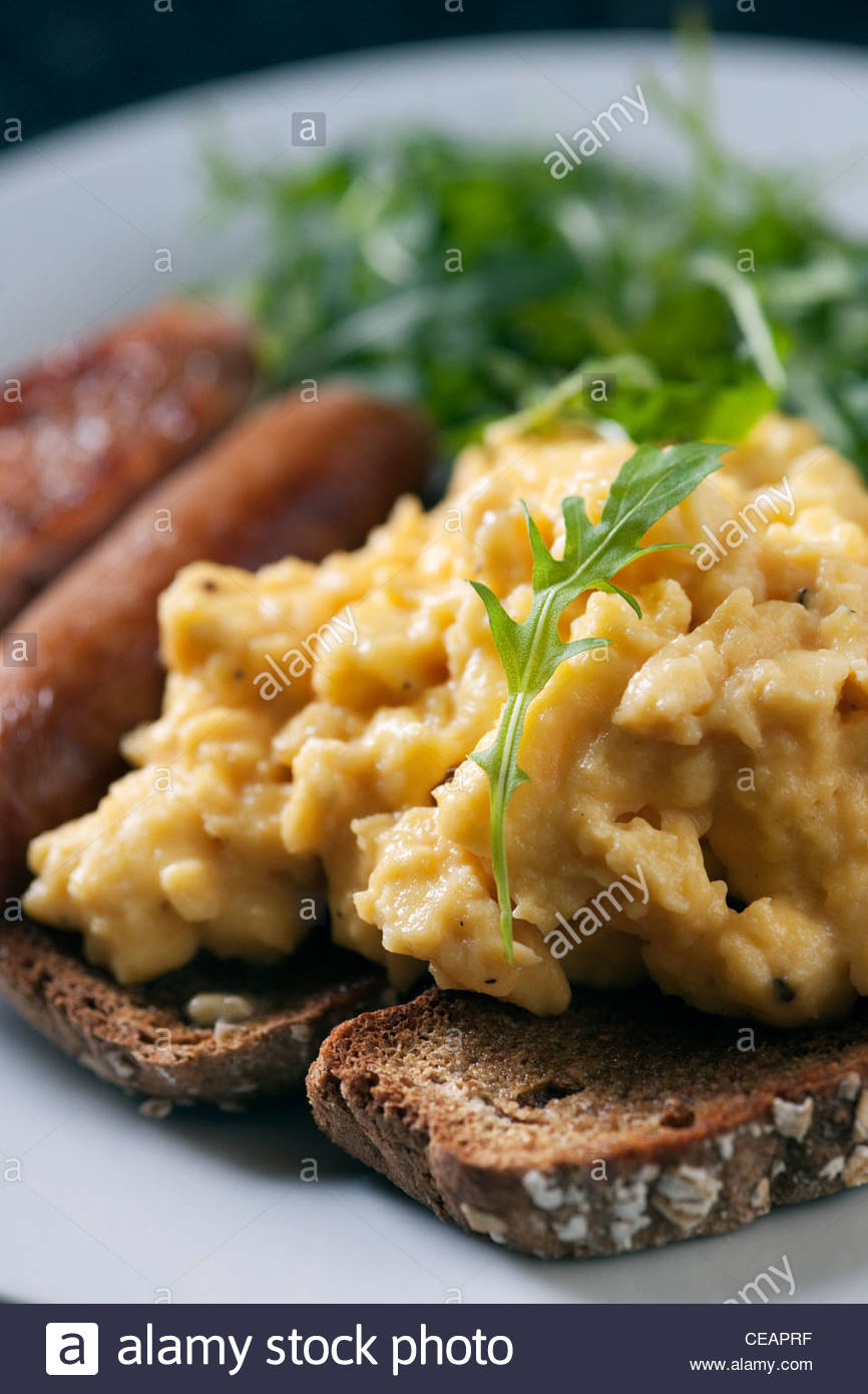 Alton Albany farm B&B's contemporary Irish cooked breakfast of toasted soda bread, scrambled eggs, sausages - Stock Image
